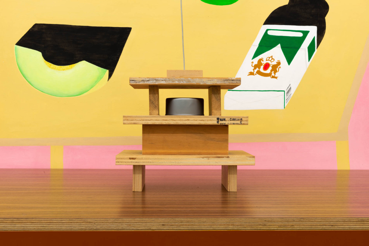 Miduny,  MiMi table , Canaletto walnut, furniture grade birch plywood and orange paint; B. Wurtz,  Untitled , wood, can, shell, wire; Crys Yin,  Melon Soap Menthol Pack, Everything is Exactly the Same , Acrylic on Paper. Photo: Yael Eban.
