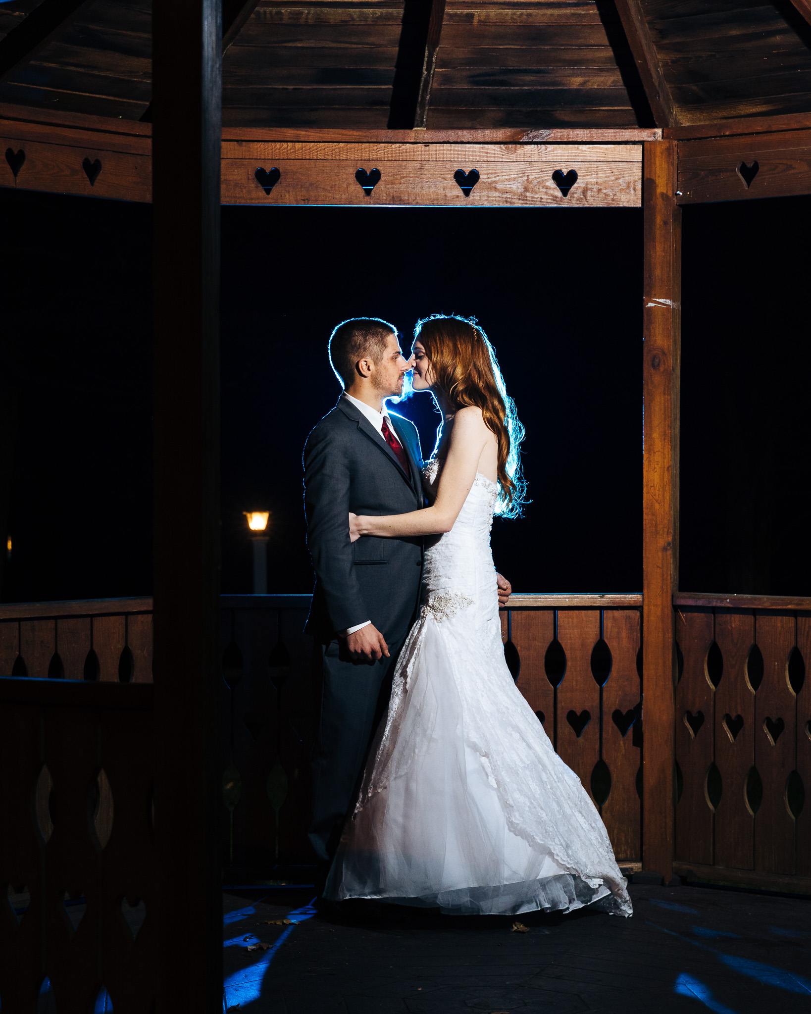 Night time low-light portrait of married couple using off-camera flash