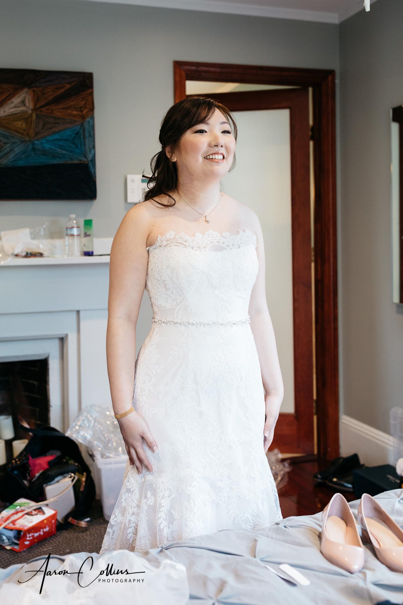The bride feeling proud in her wedding dress.