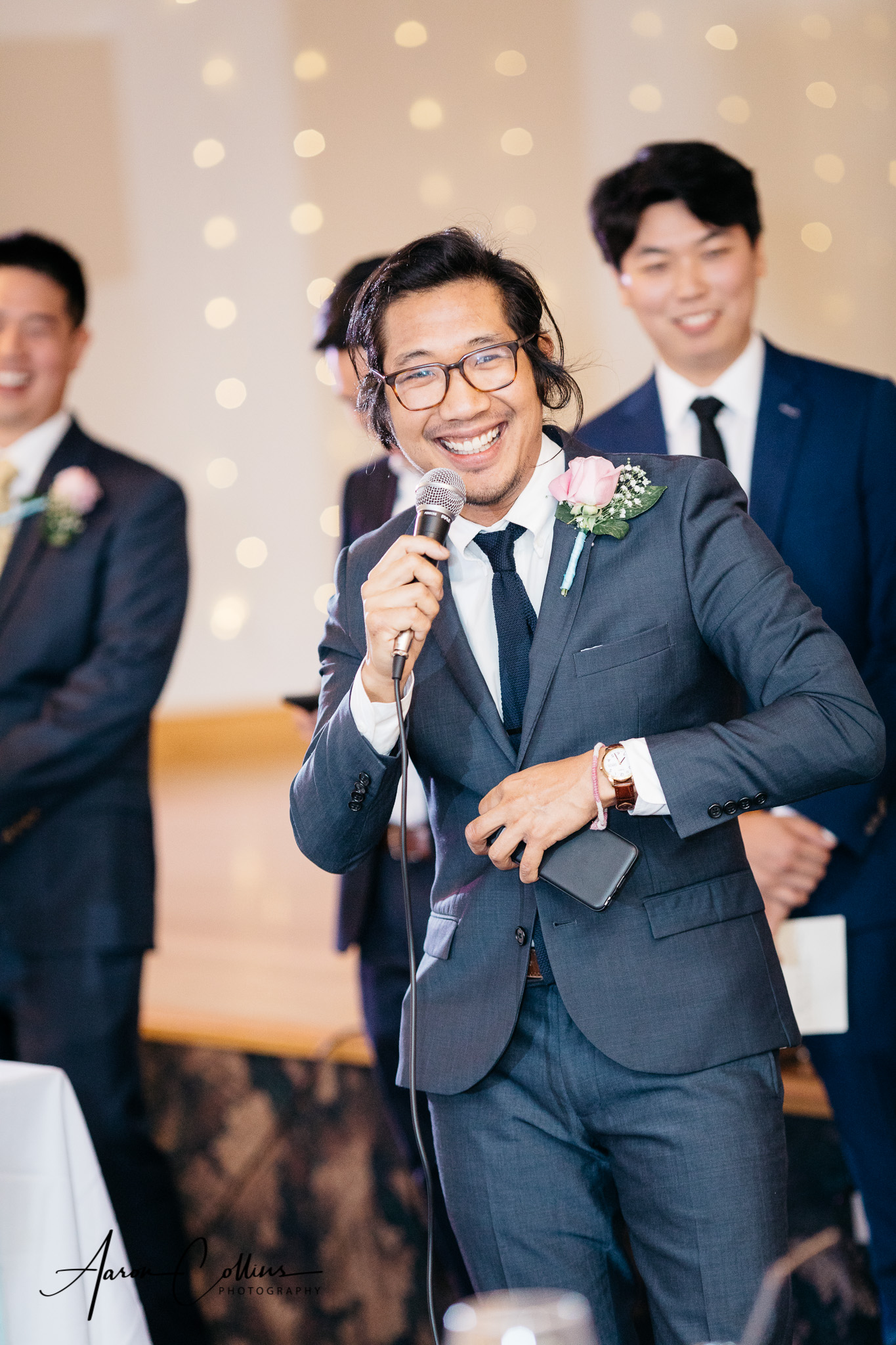 Groomsman gives a toast at the reception
