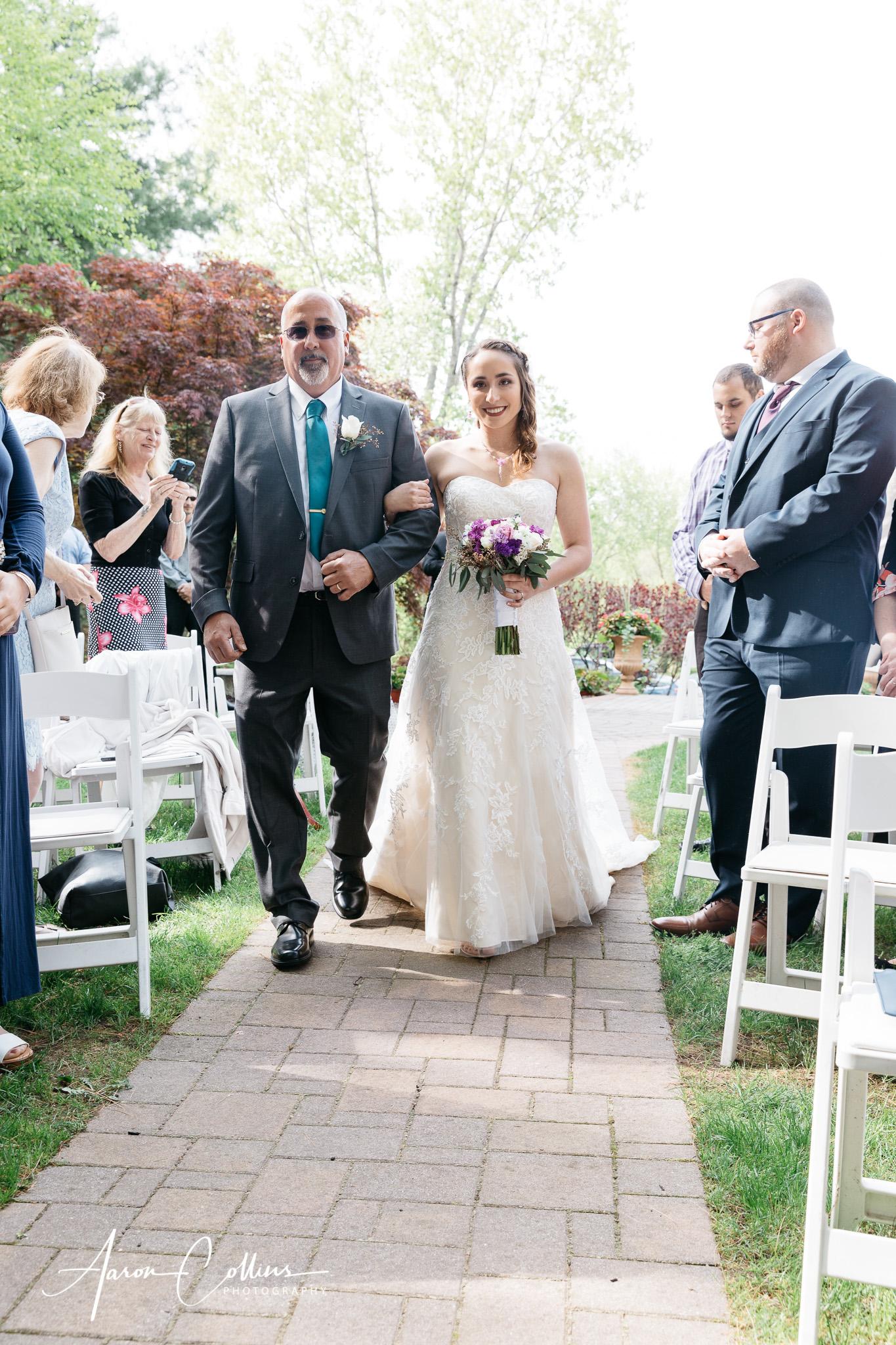 Father walking his daughter down the aisle at A Villa Louisa.