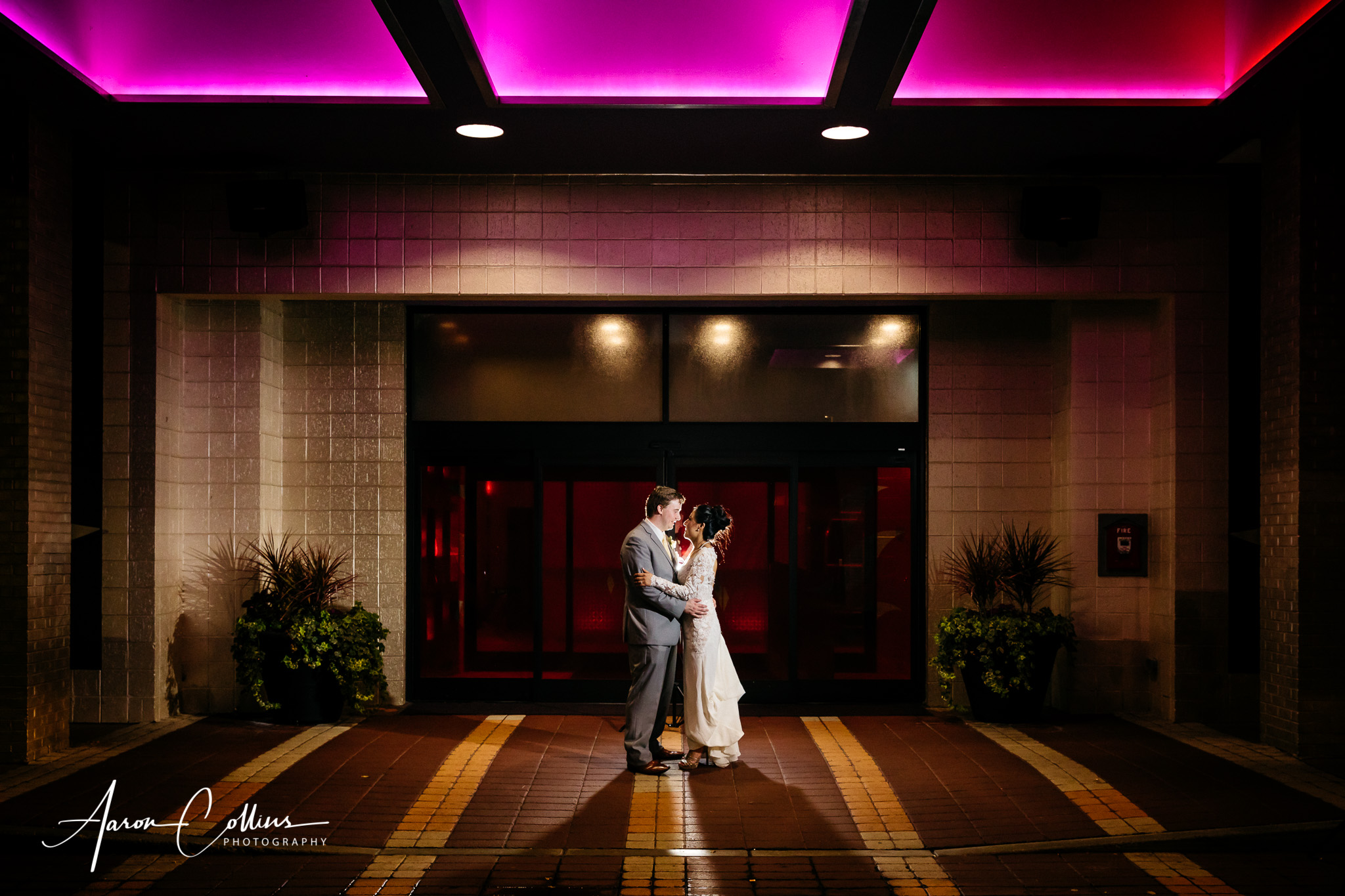 Outdoor night portrait of bride and groom outside Verve Crown Point in Natick MA.