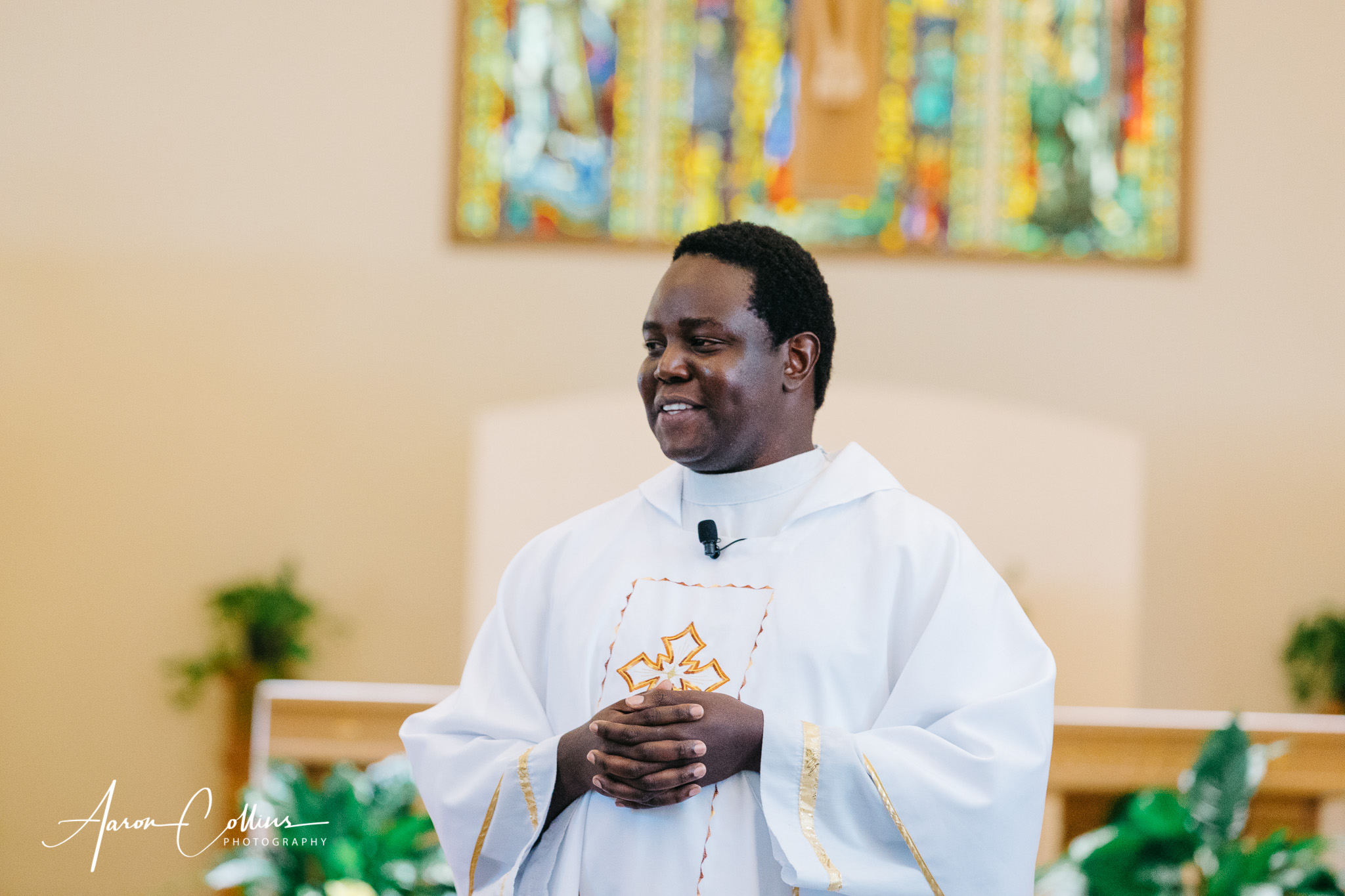Father Charles Omolo officiating the catholic wedding ceremony at Saint George Parish in Worcester MA