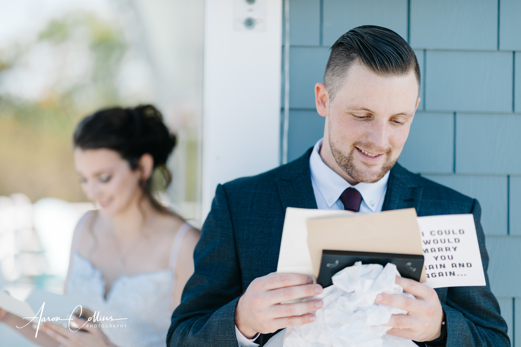 Groom looking at his gift while bride is concealed around the corner.