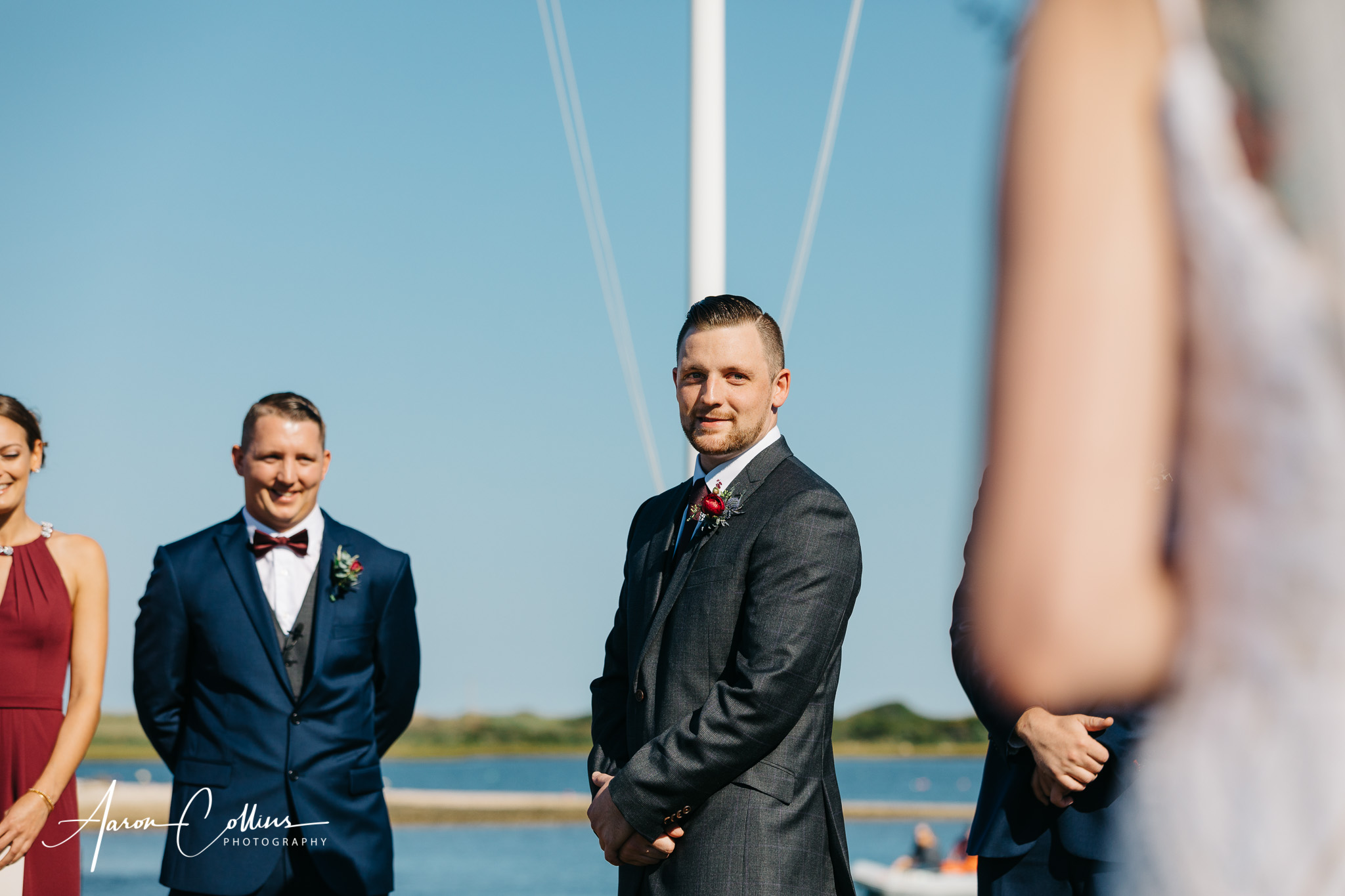 The groom sees his bride for the first time at their Block Island wedding.