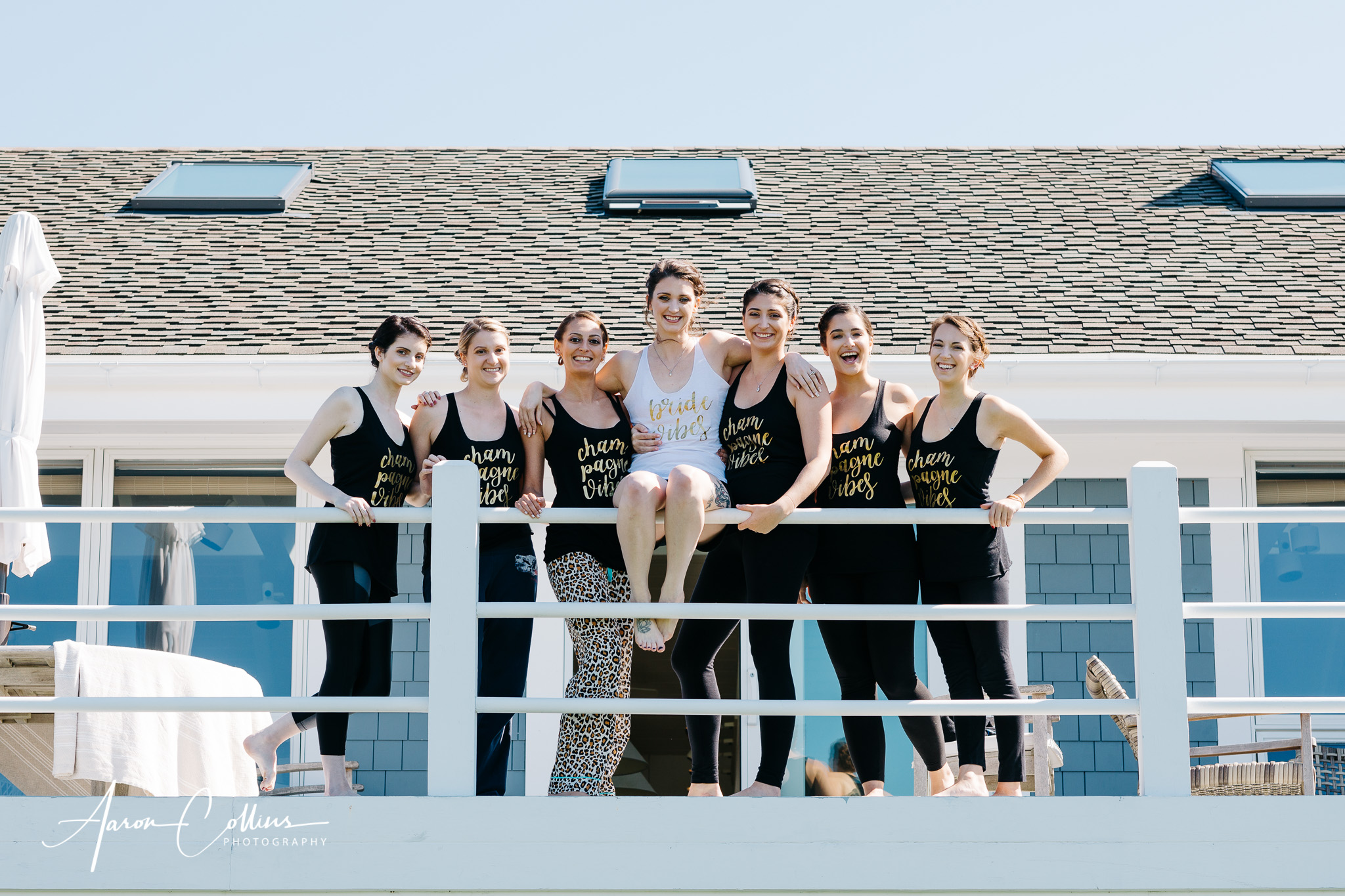 Bridesmaids hanging out on the railing at the Villakula house on Block Island just before the wedding.