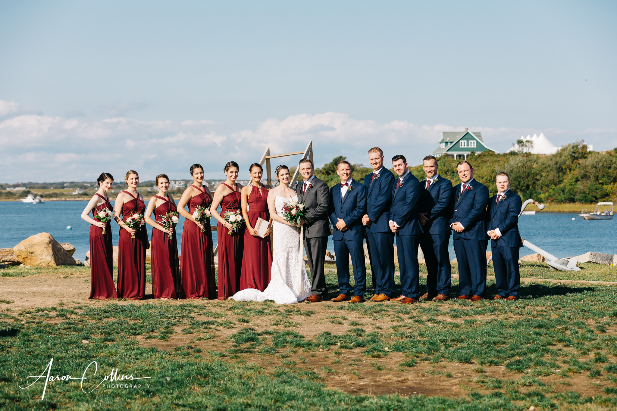 Sunny portrait of the wedding party at Block Island Maritime Institute overlooking New Harbor.