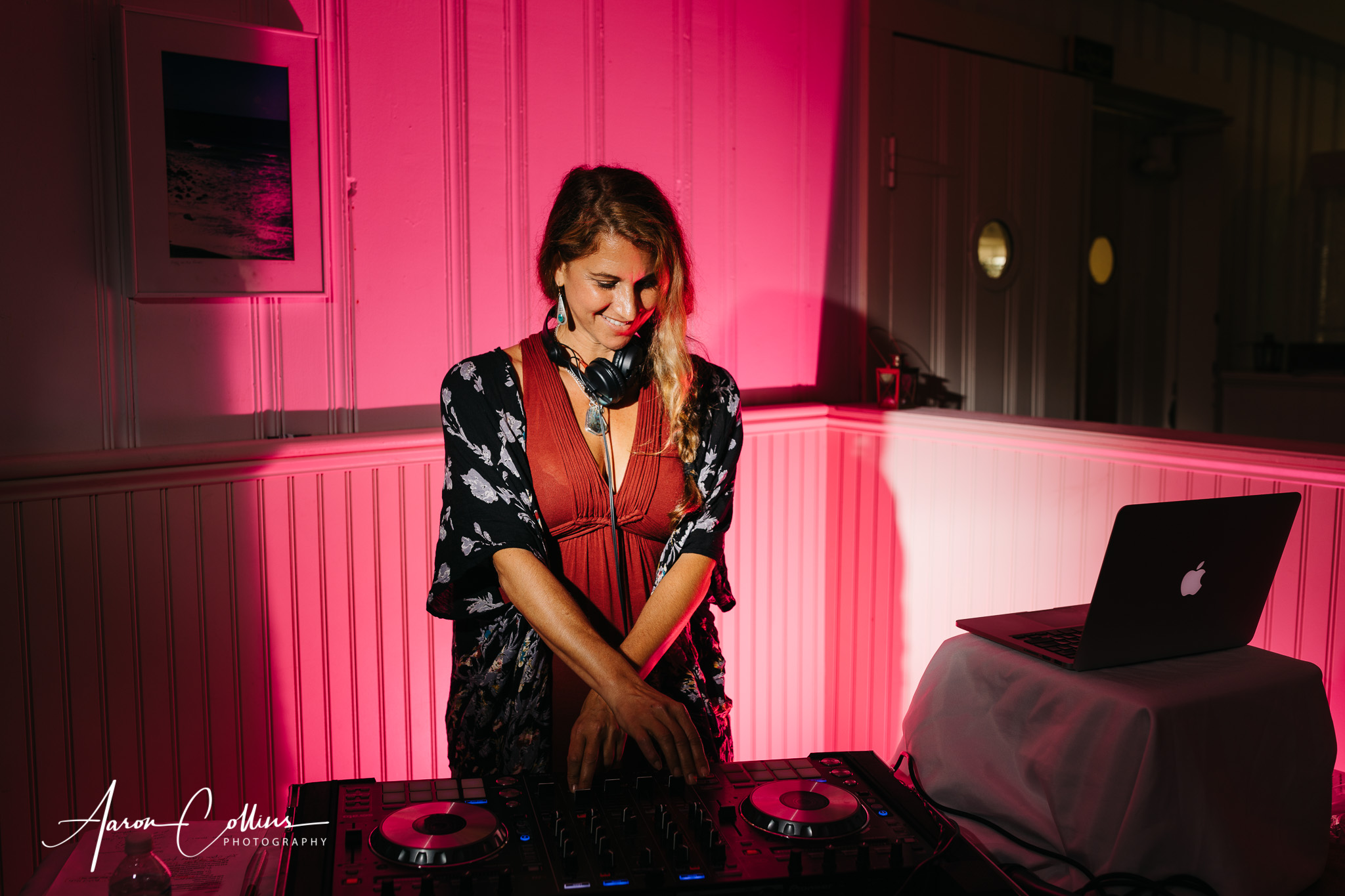 DJ Danielle C Duffy spinning the music at a wedding at Block Island Maritime Institute.