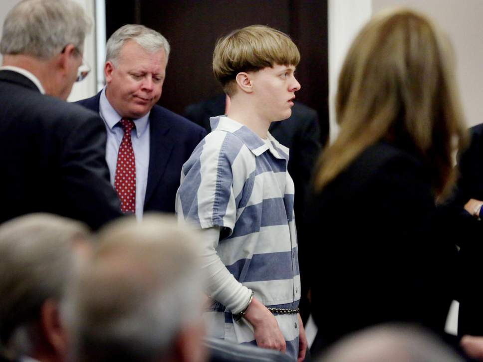 ( Independent ) Dylann Roof is escorted into the court room at Charleston County Judicial Center to enter a guilty plea on murder charges for the 2015 shooting massacre at a historic black church in Charleston, South Carolina, on 10 April 2017 ( Grace Beahm/Reuters )