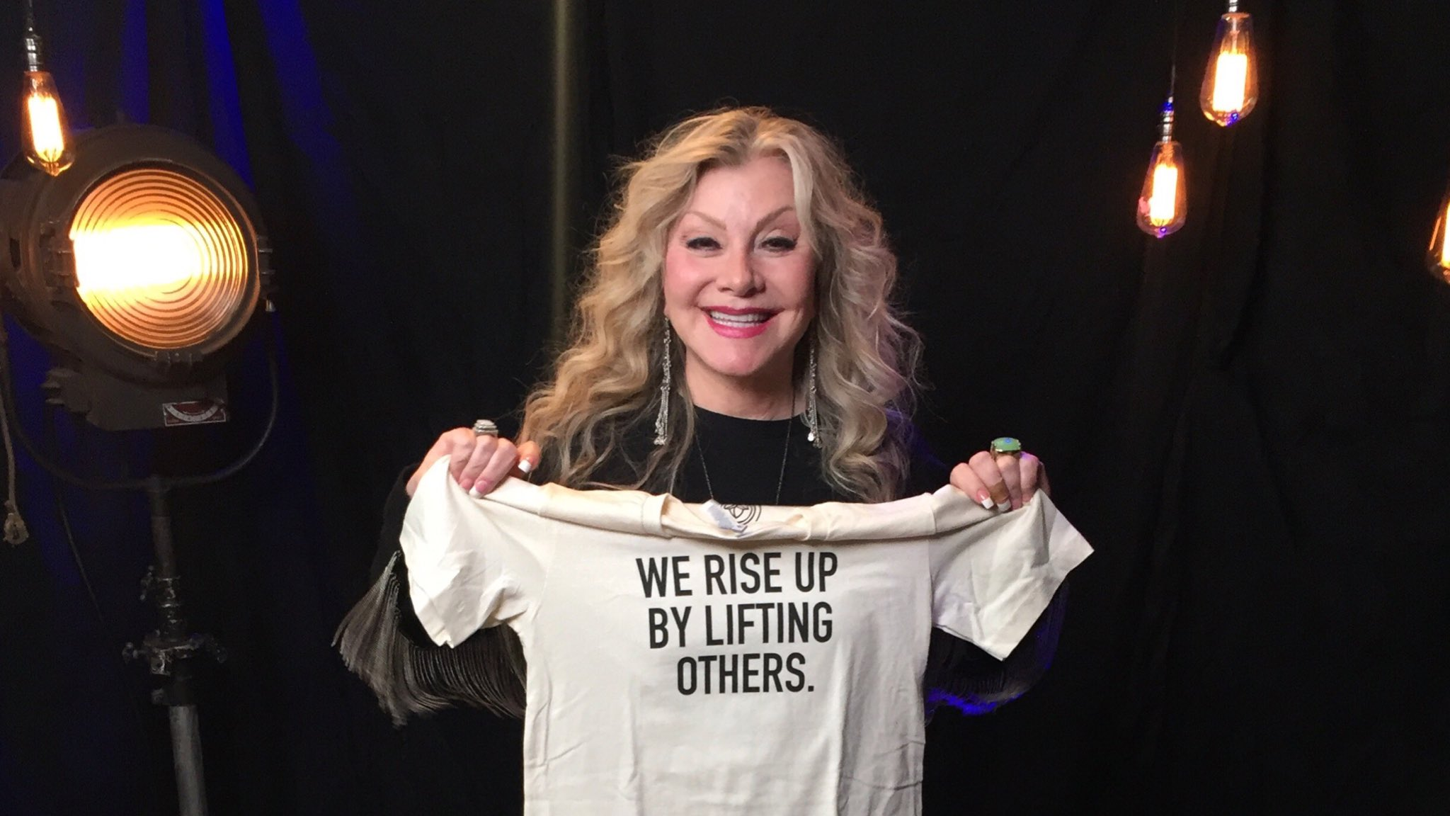 "( Twitter ) Dolly's younger sister Stella Parton poses for a photo she tweeted for international women's day & and  Project Alianza ""shining a light on all the #ladylifters out there"" and ""empowering women."""