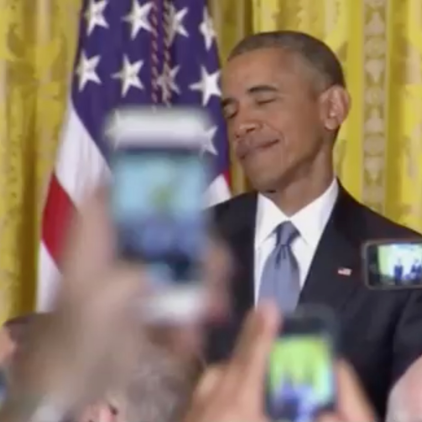 """Screenshot of Obama's face when getting heckled by a transgender illegal alien activist whom his administration invited to the White House to celebrate """"LGBT Pride Month"""" June 2015."""