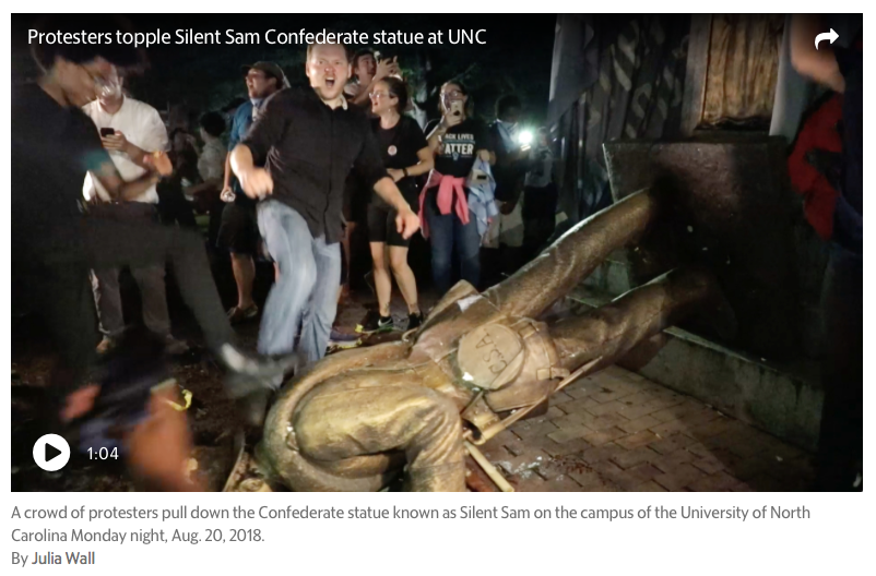(Screenshot of video from 2018 when idiots at UNC toppled Silent Sam statue — from  Charlotte Observer )