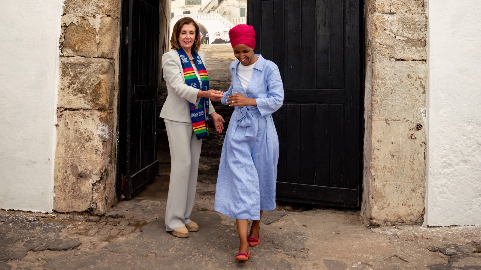 "Cropped photo taken from a  Tweet  from Ilhan Omar, saying: They said ""send her back"" but Speaker @SpeakerPelosi didn't just make arrangements to send me back, she went back with me ✊🏽 So grateful for the honor to return to Mother Africa with the @TheBlackCaucus and commemorate The Year of Return! #Doorofreturn #Ghana"