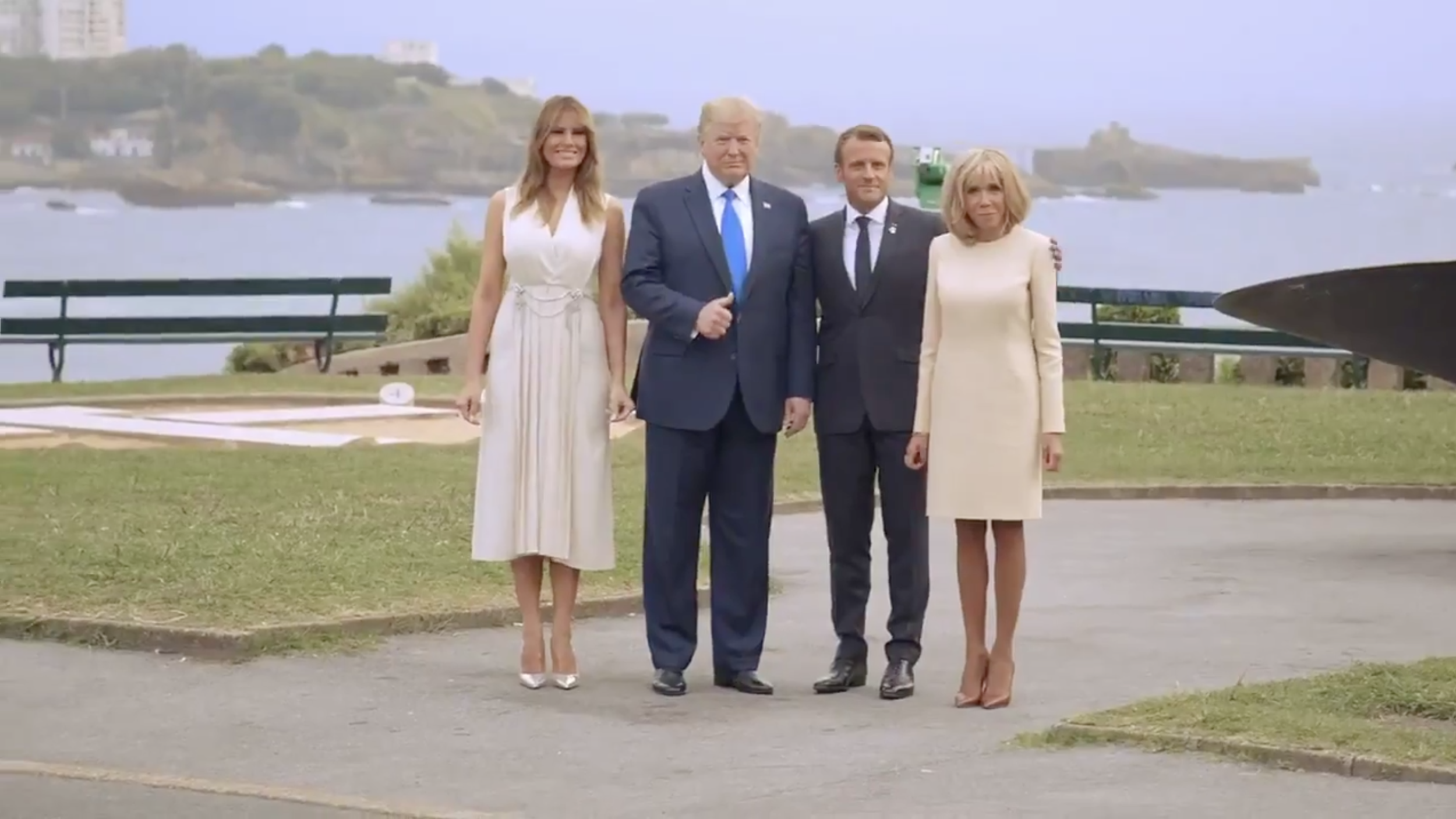 "Screenshot from White House video (posted on  Twitter ) of Trump's visit to France for the 2019 G-7 (""Group of Seven"") summit with Emmanuel Macron, and their wives."