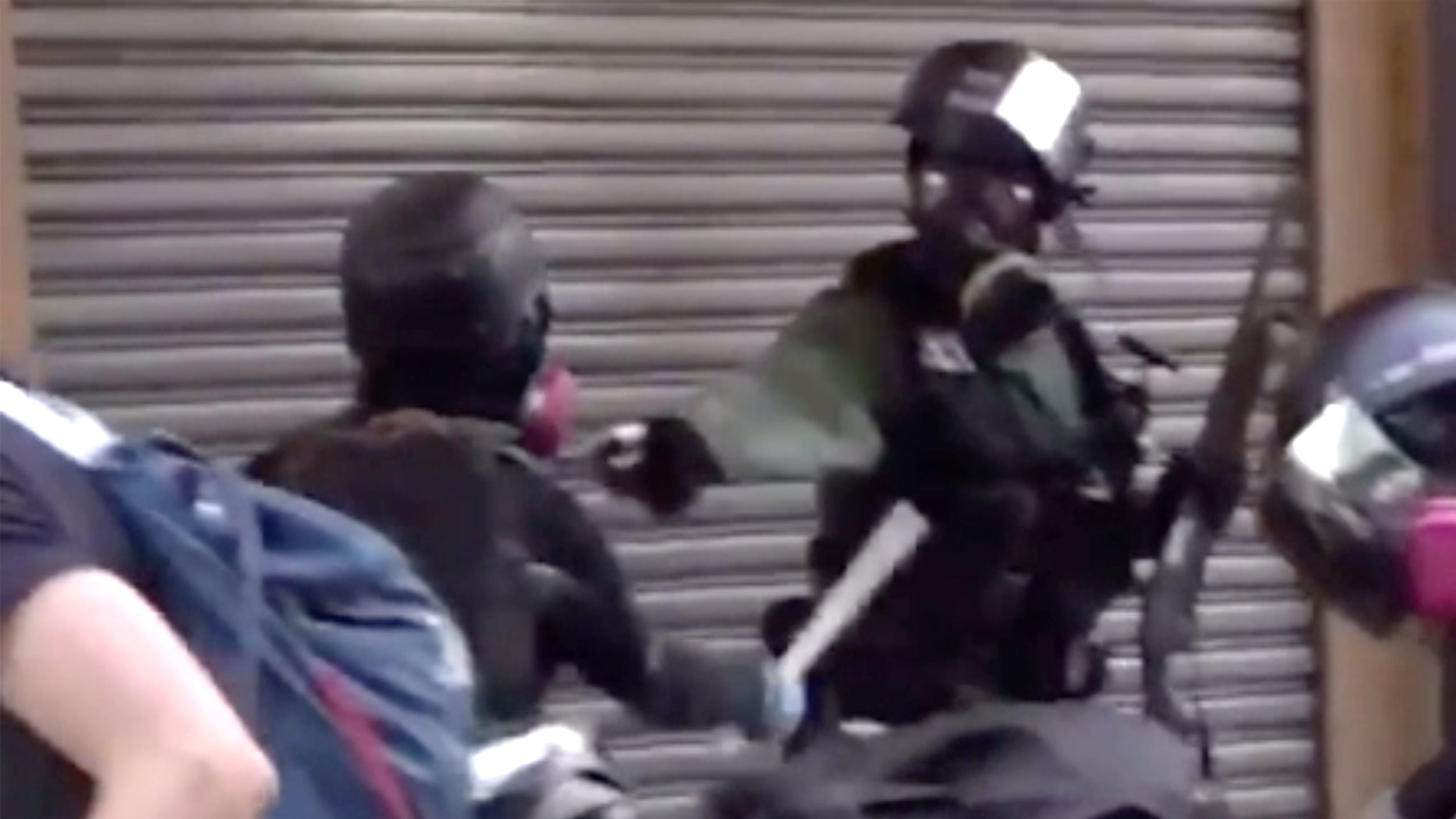 """Screenshot from  Twitter  video of """"protestor"""" getting shot after he hit the cop with a baton."""