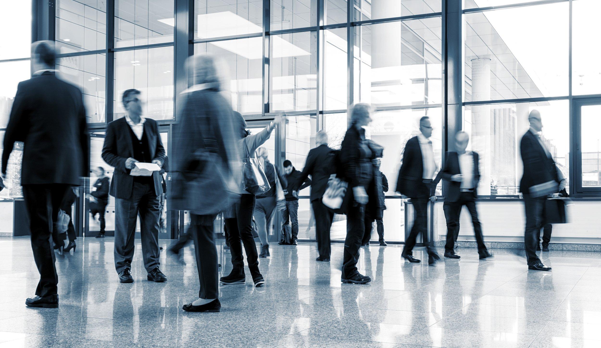 083045745-business-people-walking-commut.jpeg