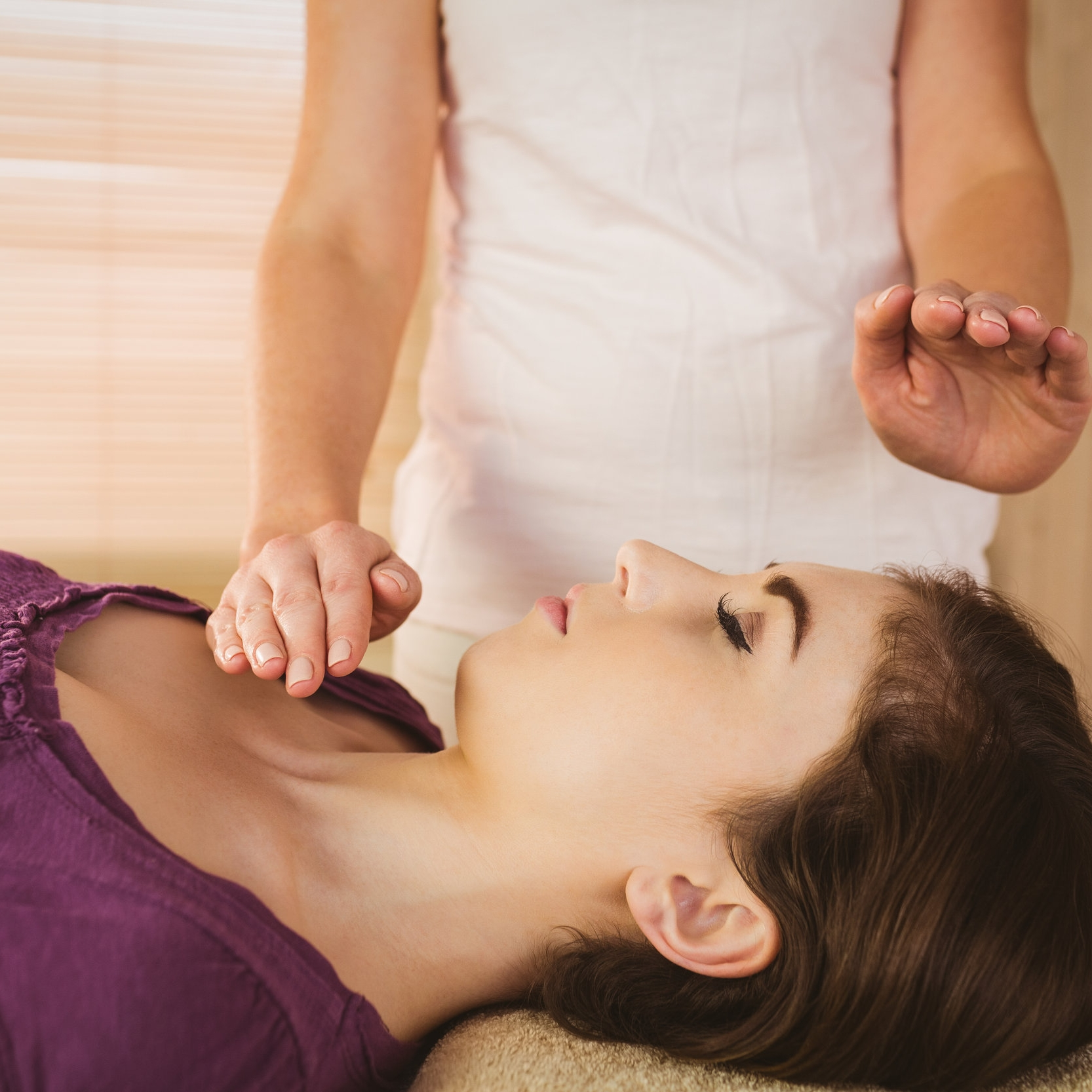 bigstock-Young-woman-having-a-reiki-tre-98065565.jpg