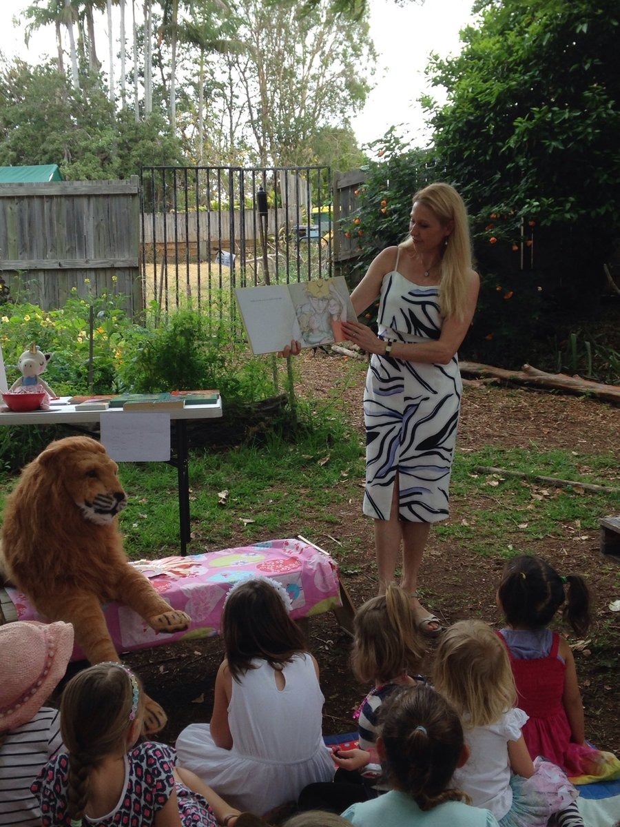 Emma reading Lion in our Living Room to a group of rapt children on the Sunshine Coast in 2017