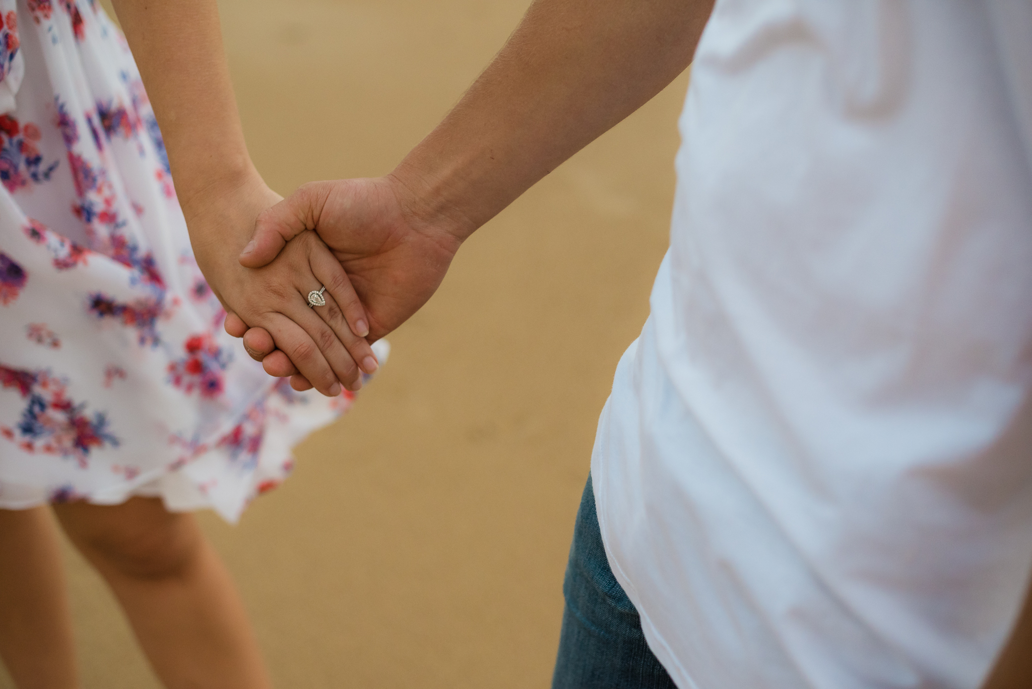 holding hands during a engagement session in sydney
