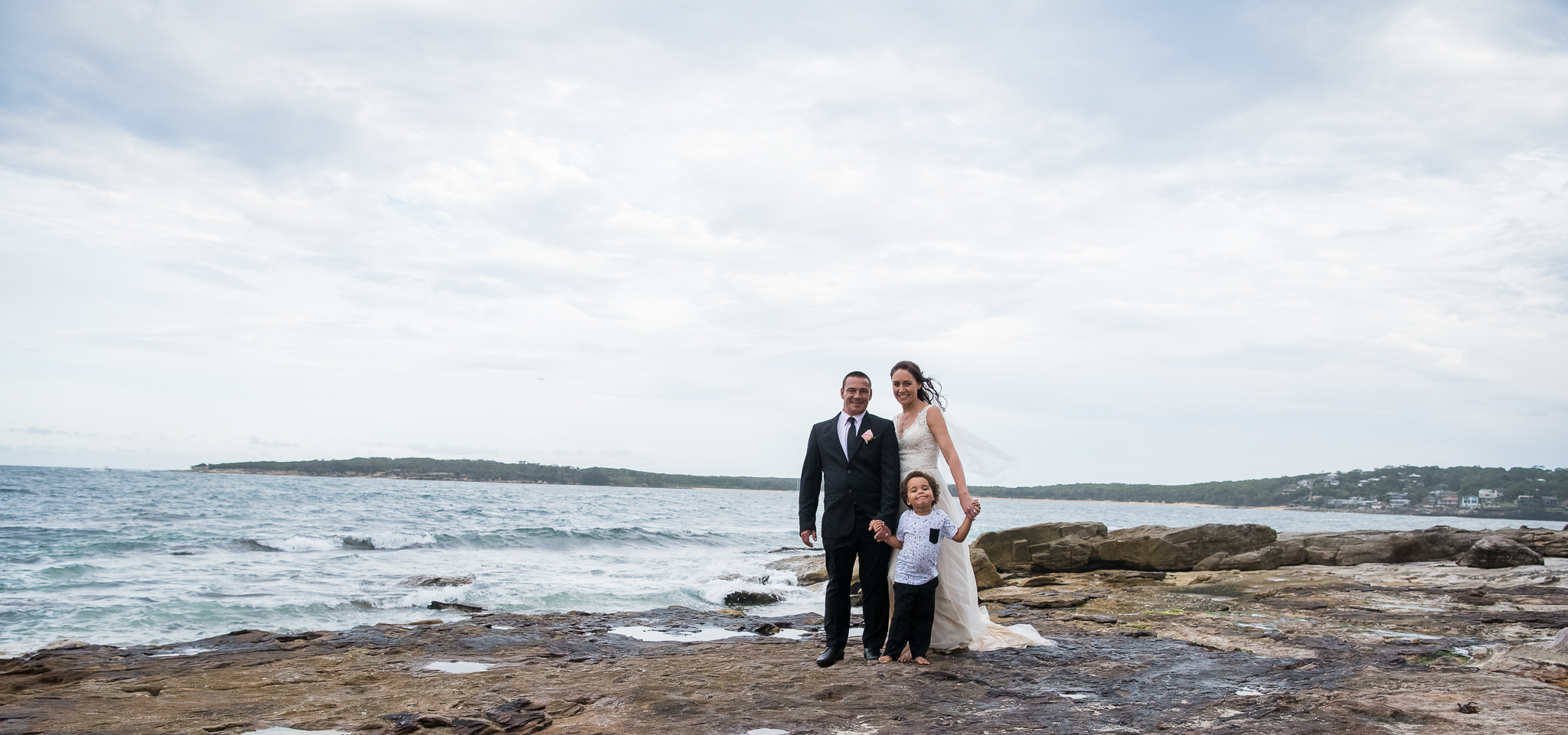 panoramic image of bridal party at the beach sydney
