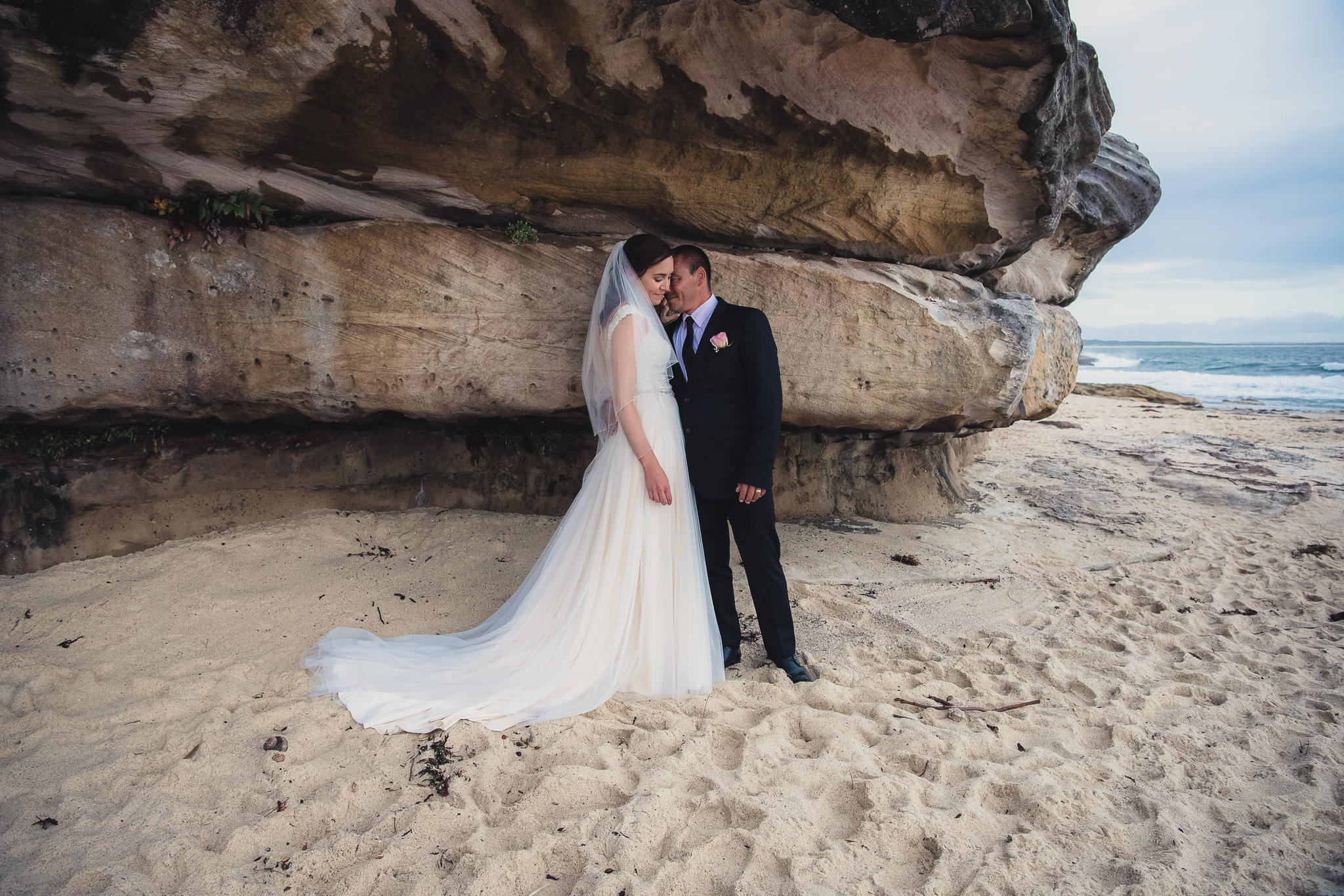 bride and groom on the beach during wedding photos