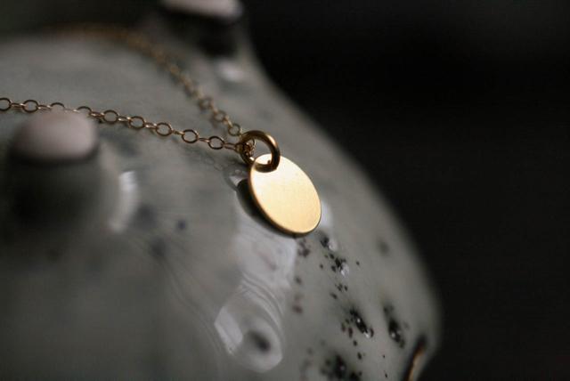 feine-Halskette-mit-Plate-10mm-vergoldet-0761.jpg