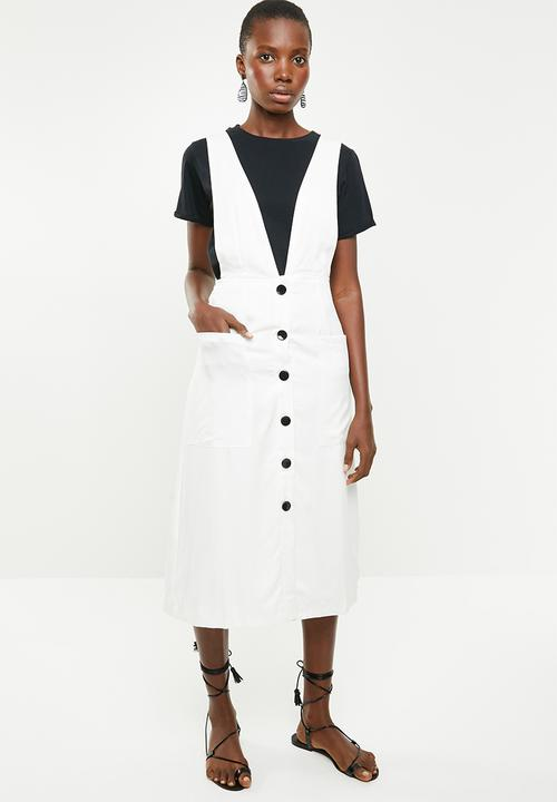 Actually a huge fan on this dress - on of the images is without a top which is actually super nice, otherwise, day to day I'd wear it with a crop top.  Sleeveless Button Through Dress from Forever 21 at Superbalist  R679