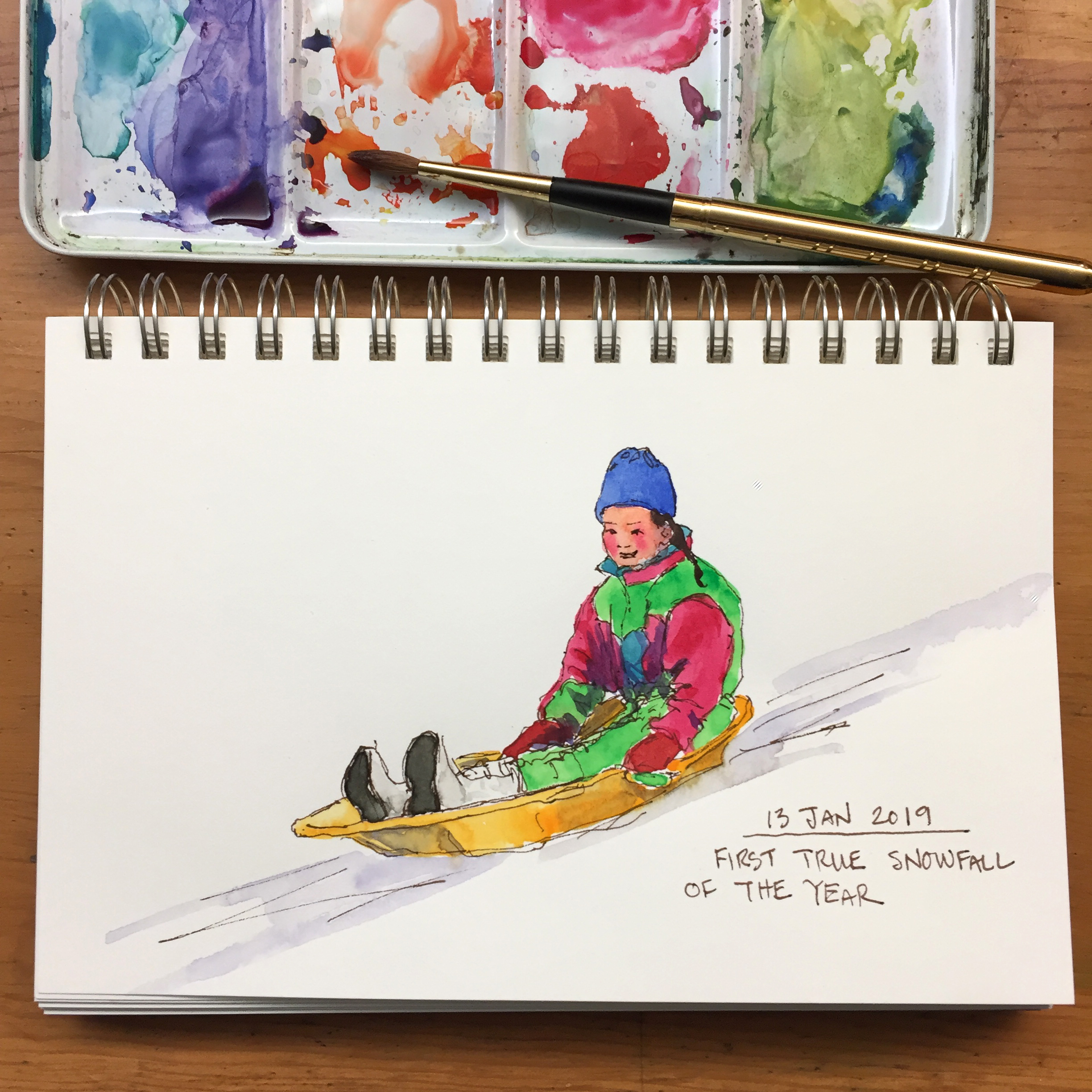 Day 13: First snow of the year. Naomi sledding