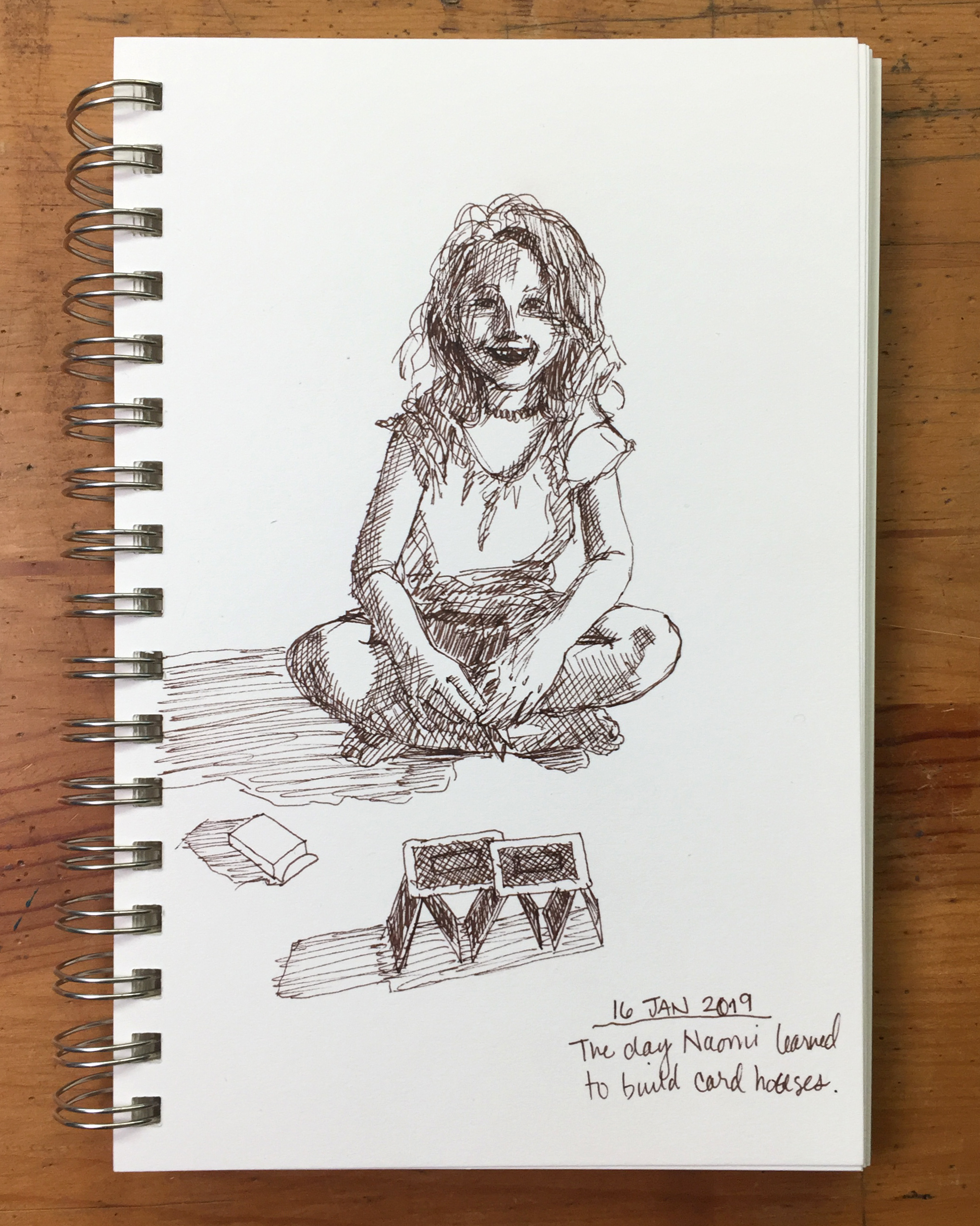 Day 16: Naomi building a house of cards