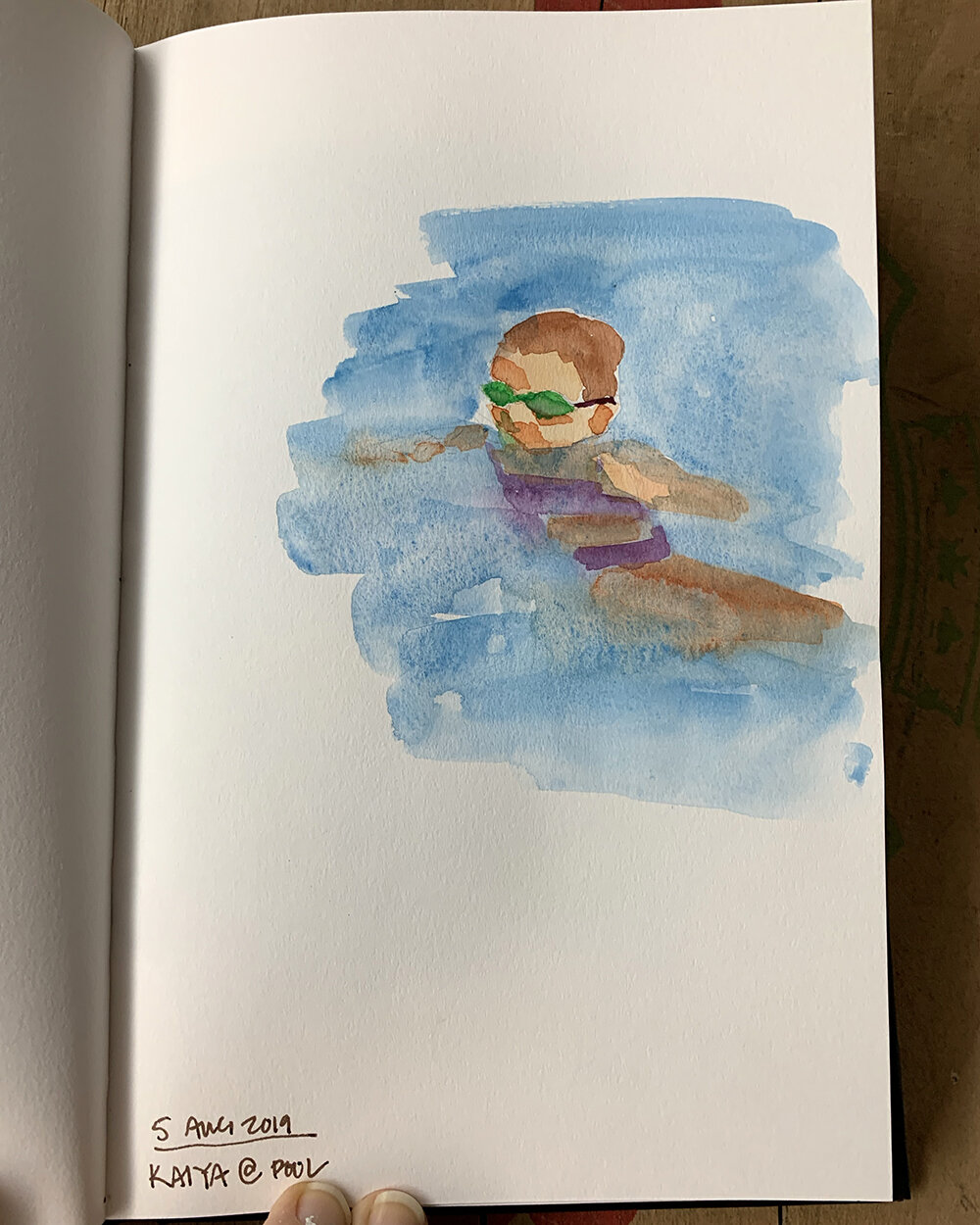 Day 217, August 5, 2019: Watercolor sketch of Kaiya in pool. I love these images of summer…. I think they might end up as an oil painting one day…