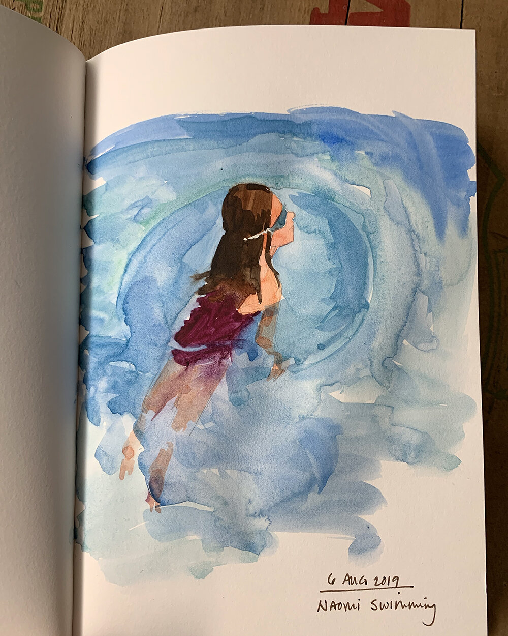 Day 218, August 6, 2019: Another watercolor sketch of Naomi in the pool. This imagery of summer never loses its appeal.
