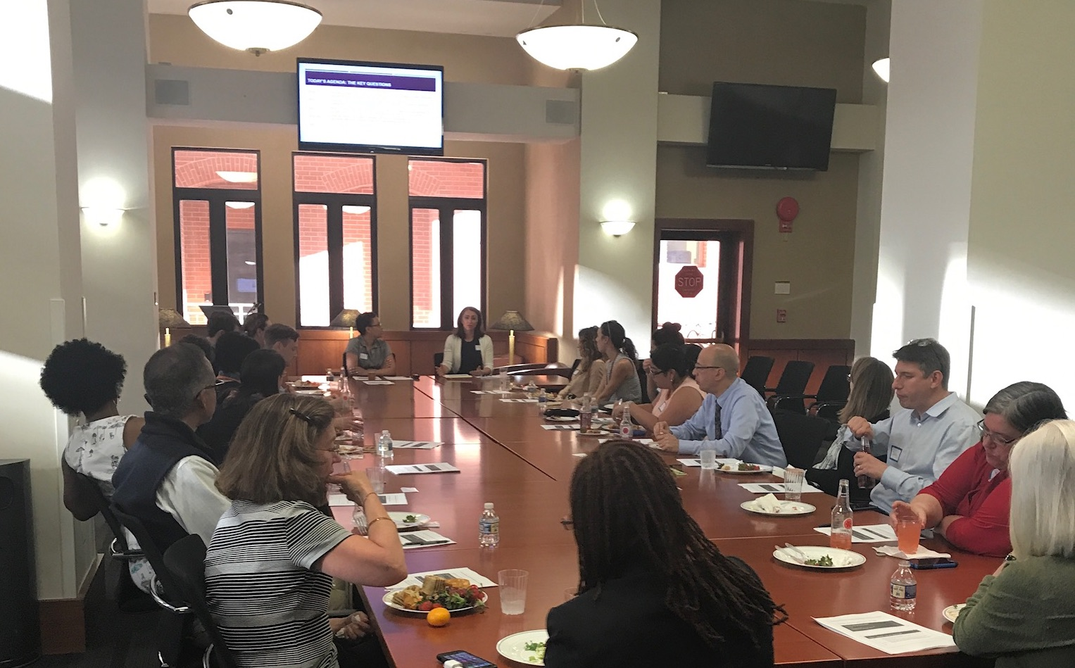 """Shauna C. Bryce with Leesa Kleeper presenting """"Success and Wellbeing for Lawyers: How can you be more successful and less stressed?"""" for Harvard Law School Association of Washington DC at George Washington Law School's law library."""
