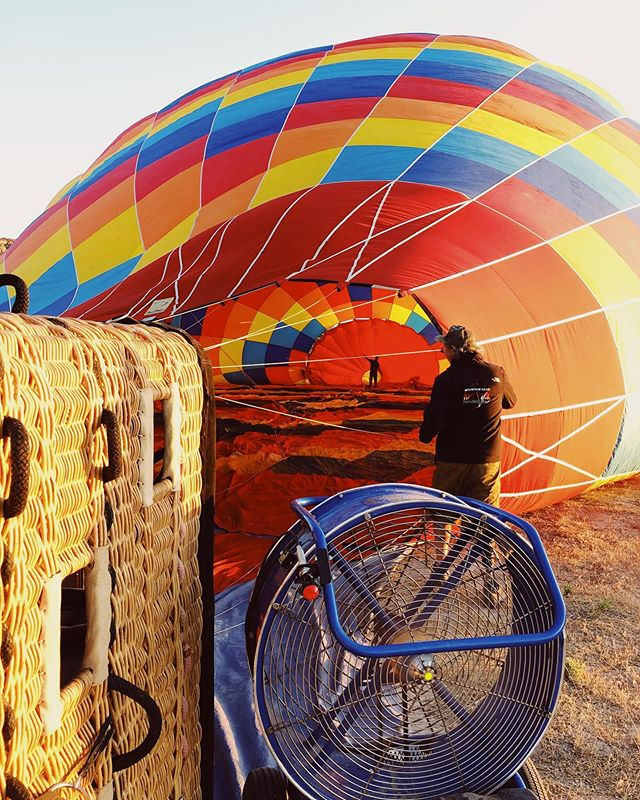 Decided at 12am that we were gonna take a hot air balloon ride. Woke up at 5:30 am, got to see the sunrise, hopped in a balloon, floated over Moab, had a crash landing of about 20 mph, got dusty, cried tears of laughter then drank champagne. #moabmagic has begun. We out here in the desert!