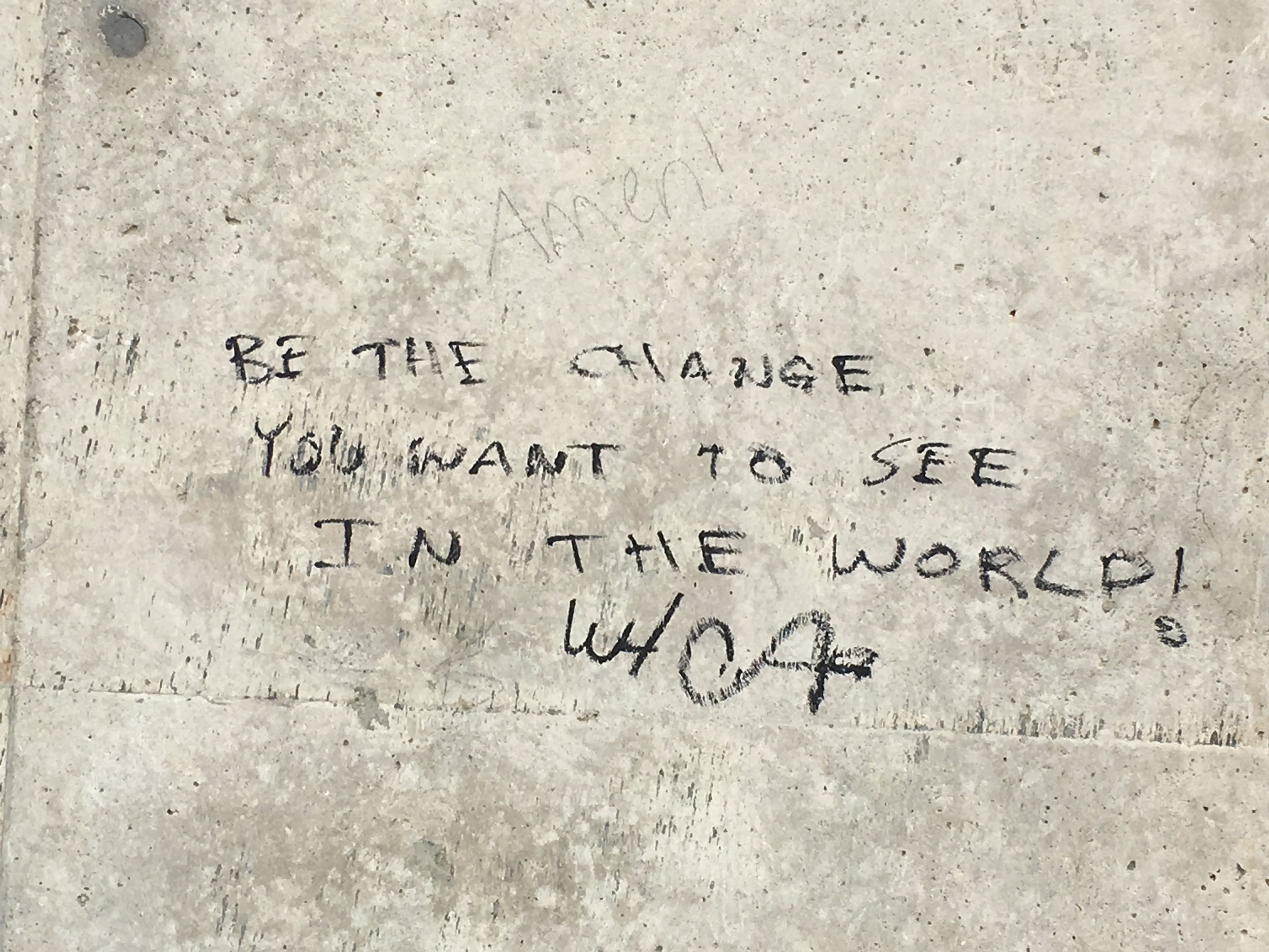 "Anonymous quote on the bridge support in Cuyahoga - ""Be the change you want to see in the world!"""