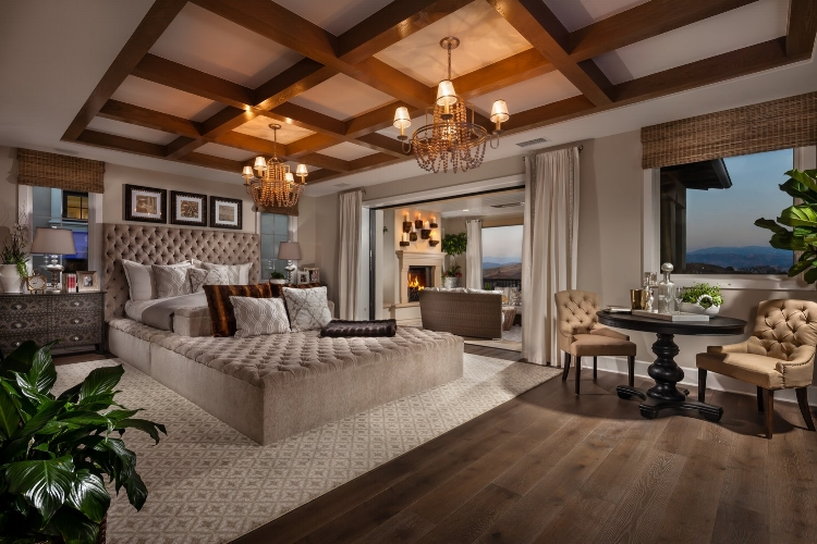 The Master Bedroom at Portofino by  Toll Brothers  has everything you could dream of, from a blissfully large custom bed to comfortable seating, gorgeous lighting and a private outdoor living space.