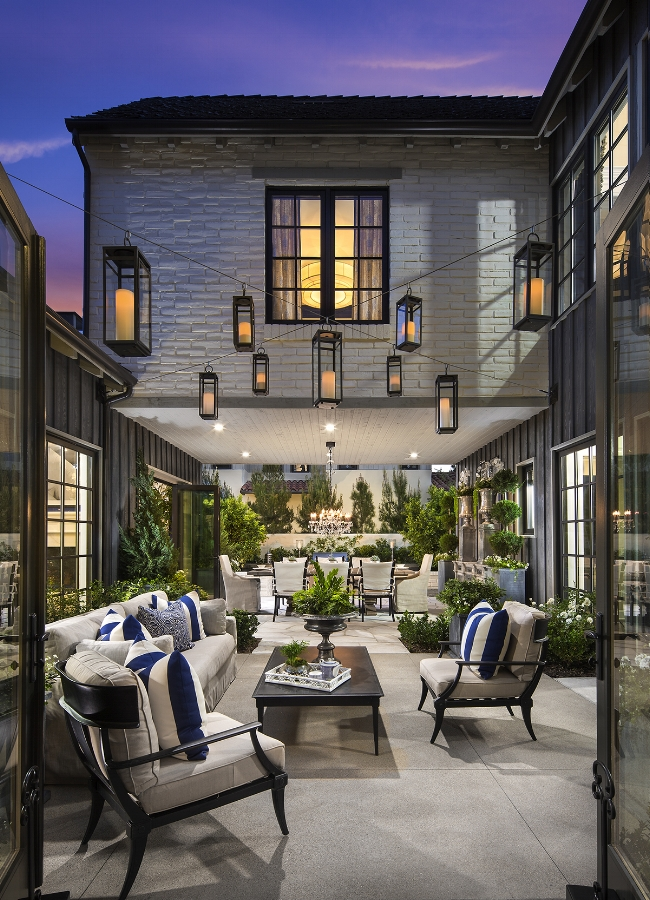 The outdoor courtyard of The Oaks Farms Residence 3 by  Davidson Communities