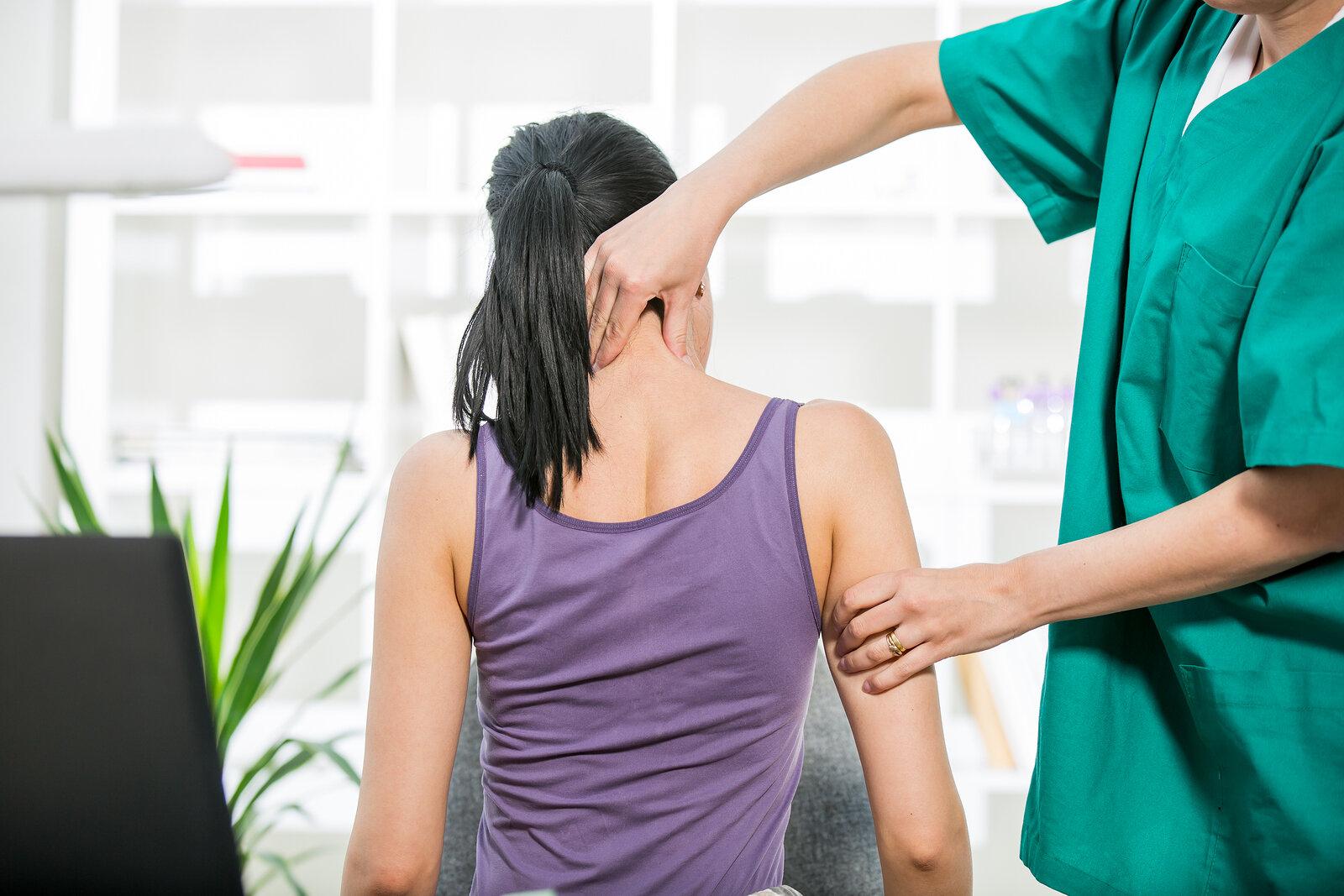 bigstock-Chiropractor-adjusting-neck-mu-86076053.jpg