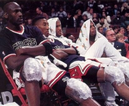 Jordan and Pippen with ice-pack cryotherapy on the court.