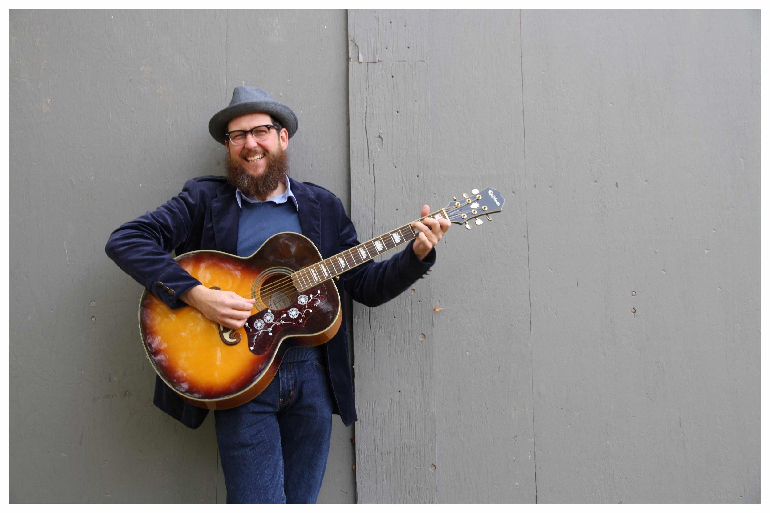 Greg Promo Guitar Smile.jpg