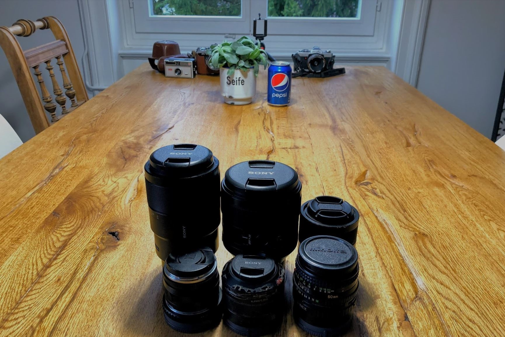 the lenses and the pepsi can