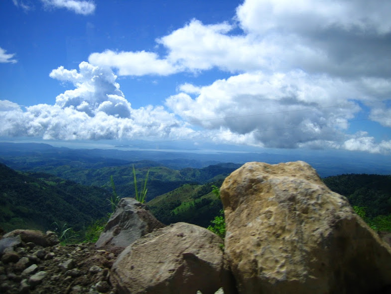 This photograph shows the majestic and picturesque serenity of Costa Rica. The sky's clouds roll on throughout the day, while the soft wind blows and moves the grass and leaves on the mountains. The photo is a beautiful contrast between the rock and the sky; they clash in a way that is most amazing. This is a place that people must see in real life, and not just through a lens, because when you see it with your own eyes, it will definitely make you gasp.   Words by Anthony Stilwell, photo by Lucille Glassman.