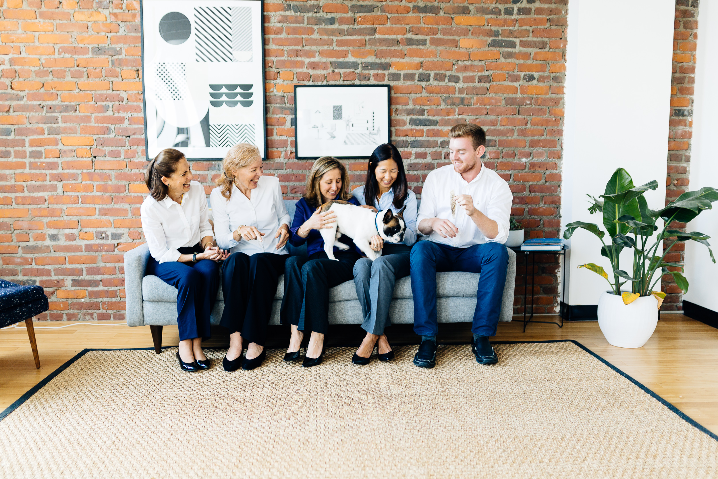 Isabel Saltzman, Susan Dahl, Jessica Grande, Liz Darling, Doug Dahl and Moses of LEVATUS Wealth Services