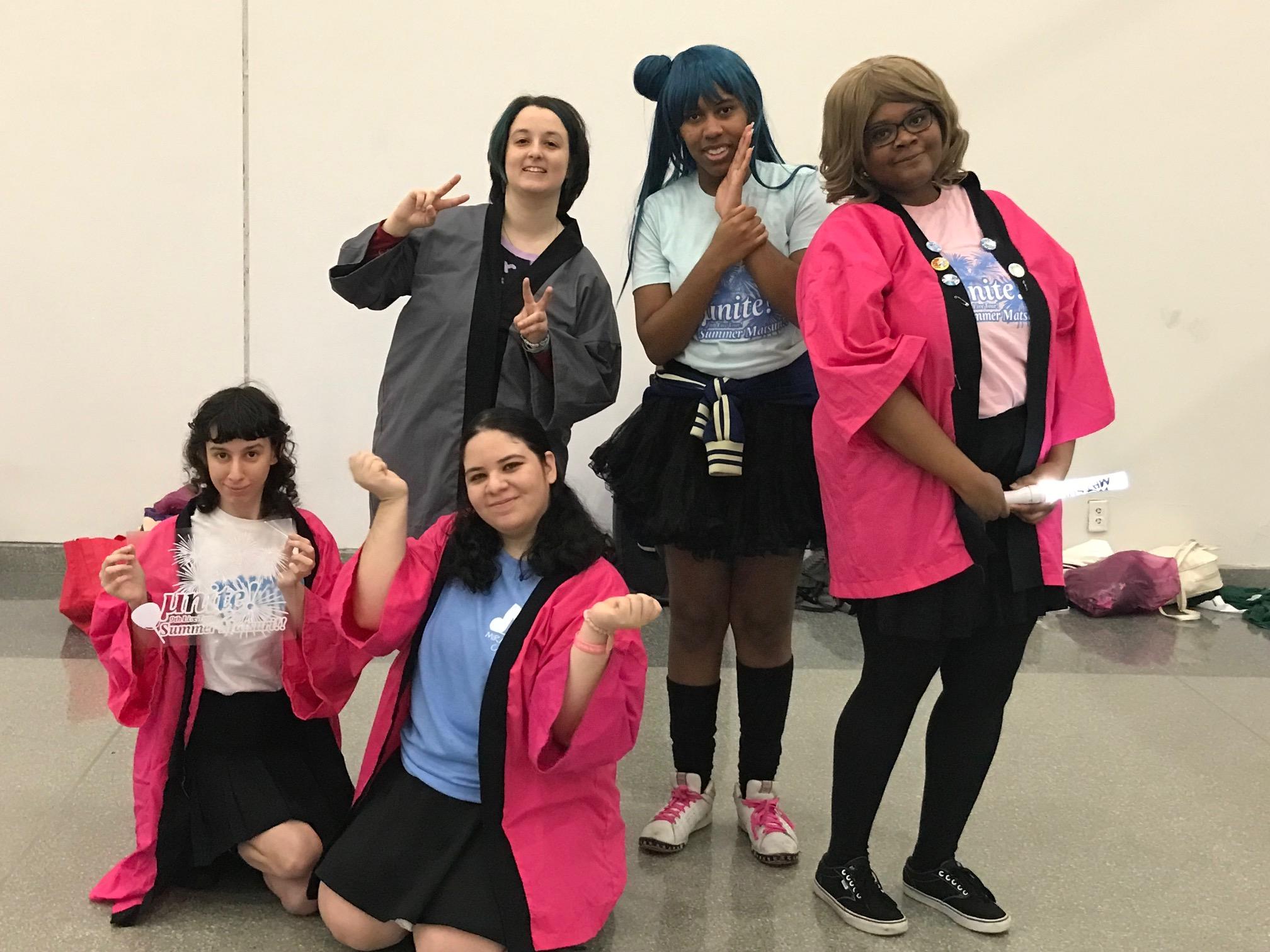 μnite's members clockwise starting from the left: Kasumi? (the question mark is intentional), Kaiju (who has a twin named Cherry Melody not present in this image), Viola, Nye, and Harmonia.