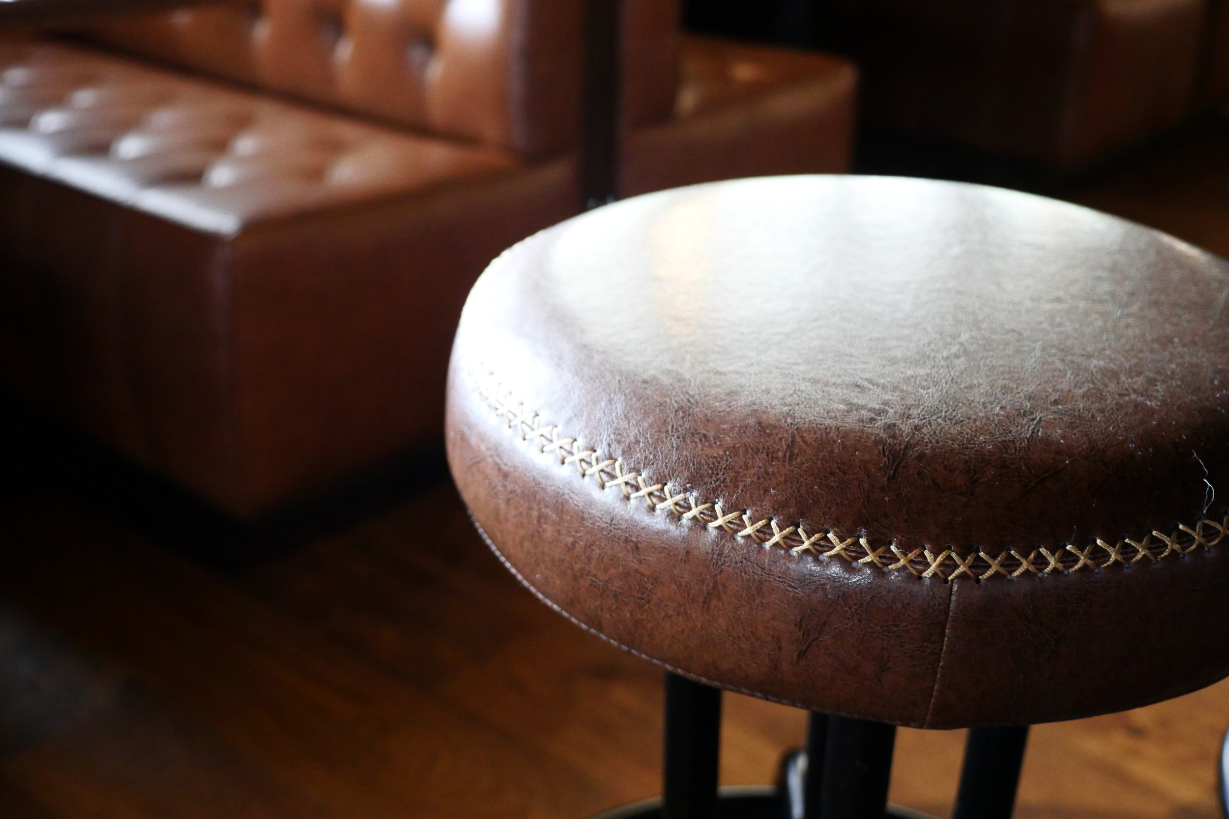 Bar stools by Nuevo feature stitching resembling football laces.
