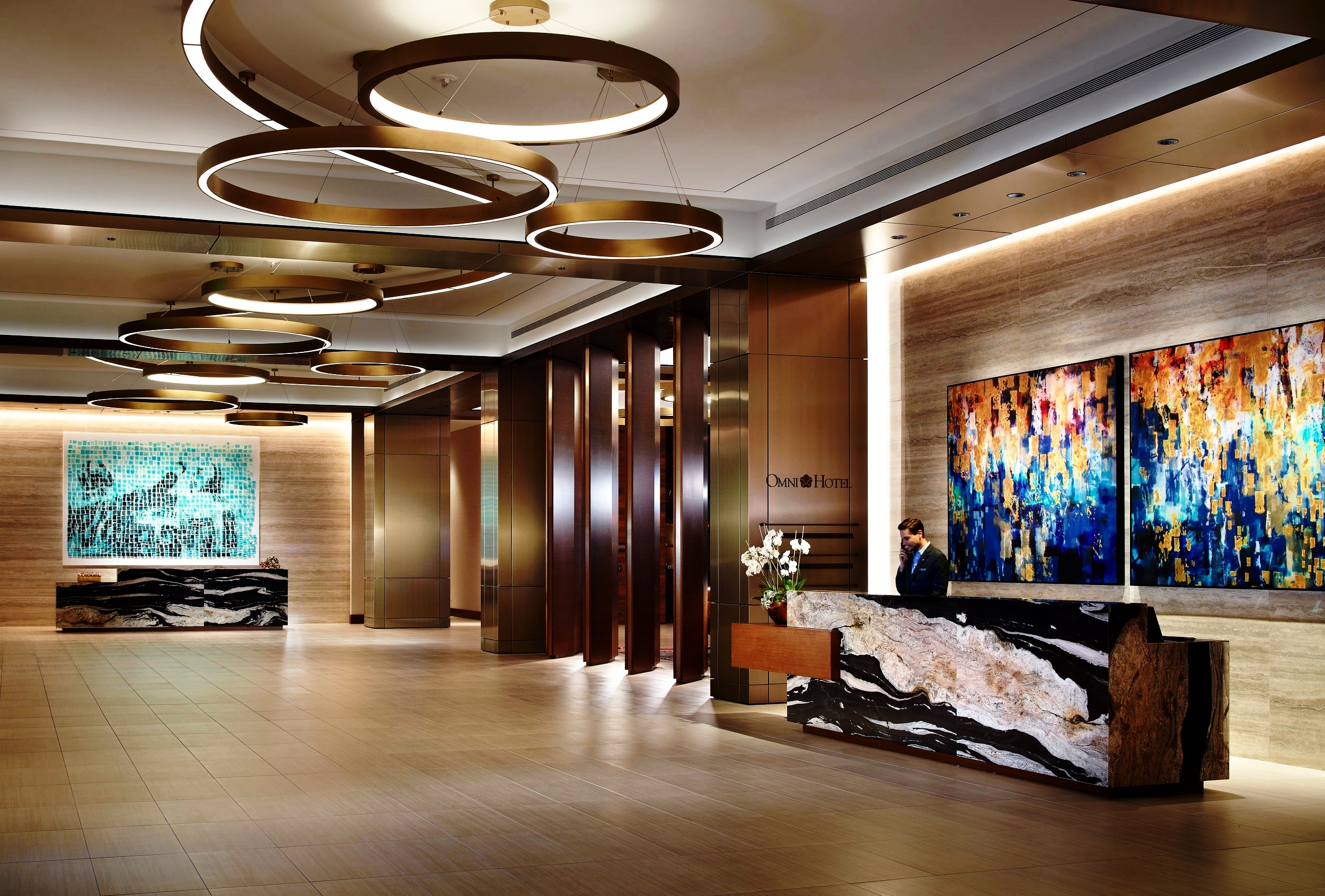The reception area is a modern interpretation of Frisco's rich heritage, which sets the tone for the entire guest experience.
