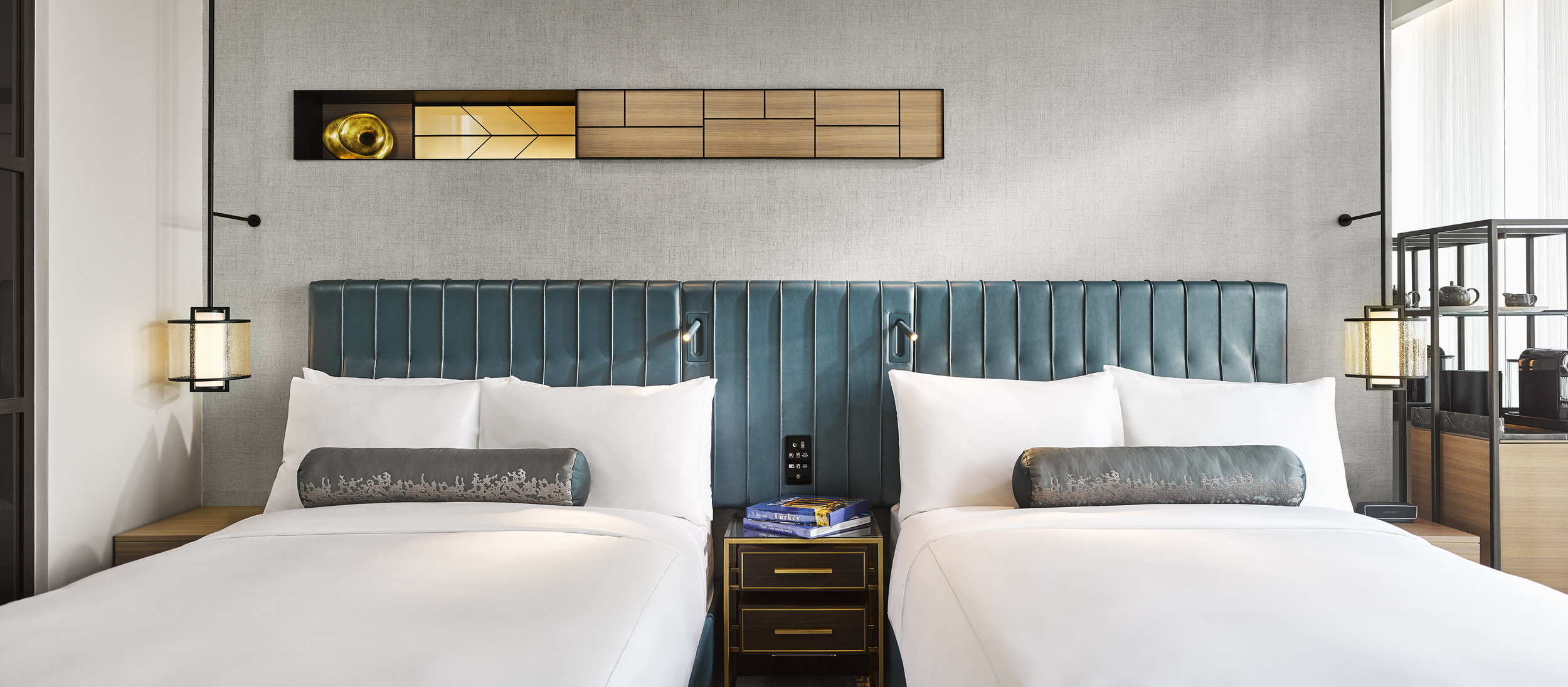 Beds feature blue leather and tufted headboards, inspired by the Bosphorus, and have a custom extruded lumbar support.