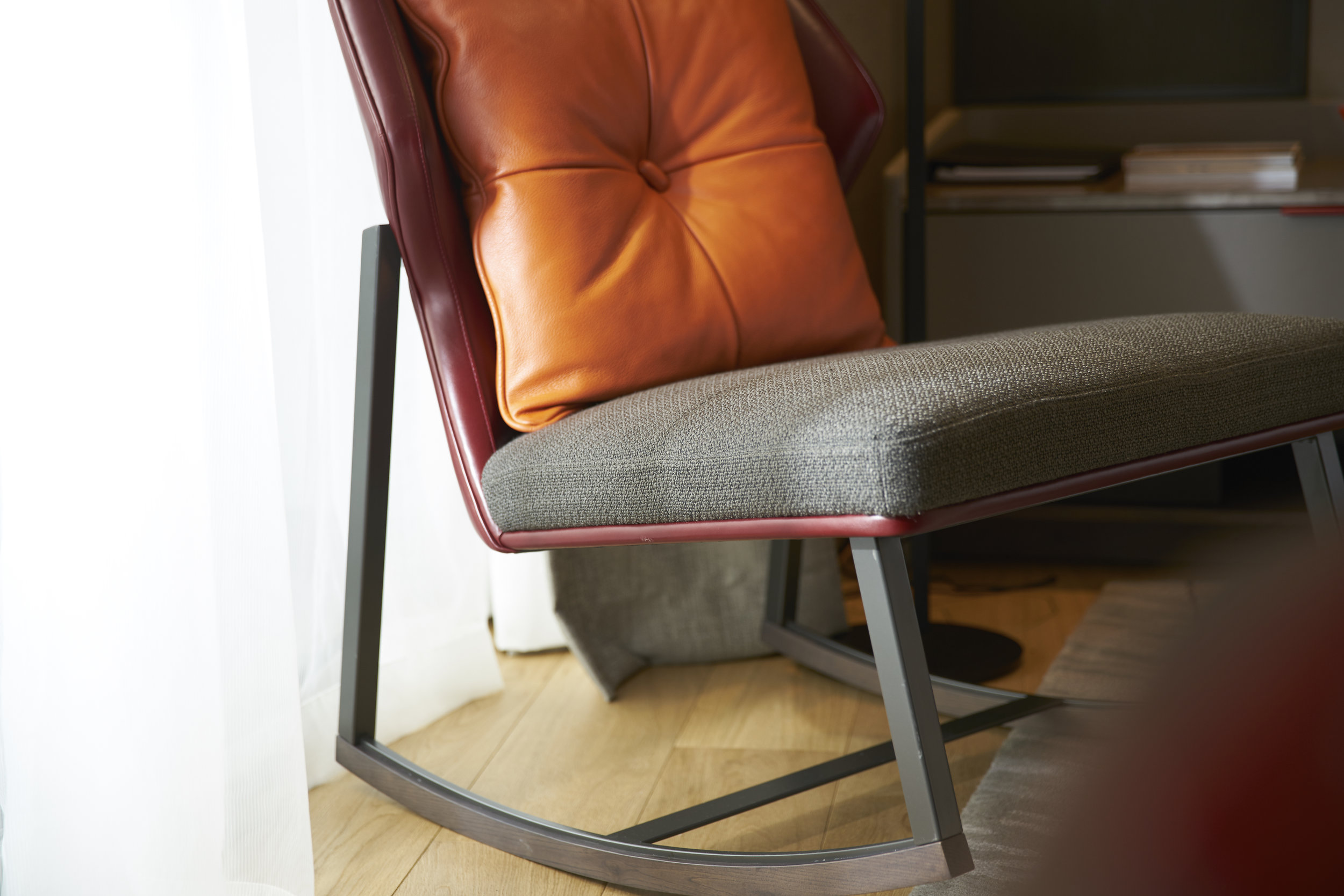 The accent chair is a modern rocking chair.