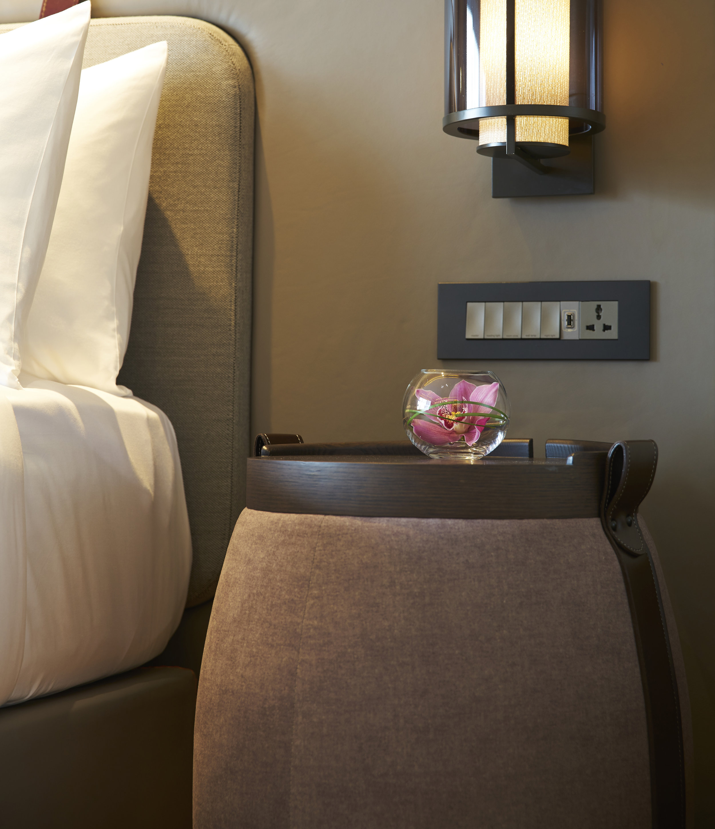 One of the bedside tables is a modern take on the Swiss life-saving brandy barrel.