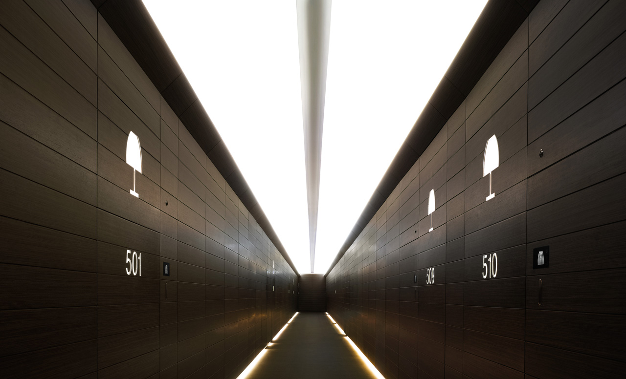 The guest corridors, with their zebra paneled wood, are trimmed with LED cove lighting at the base for a sleek look resembling a sci-fi catwalk.