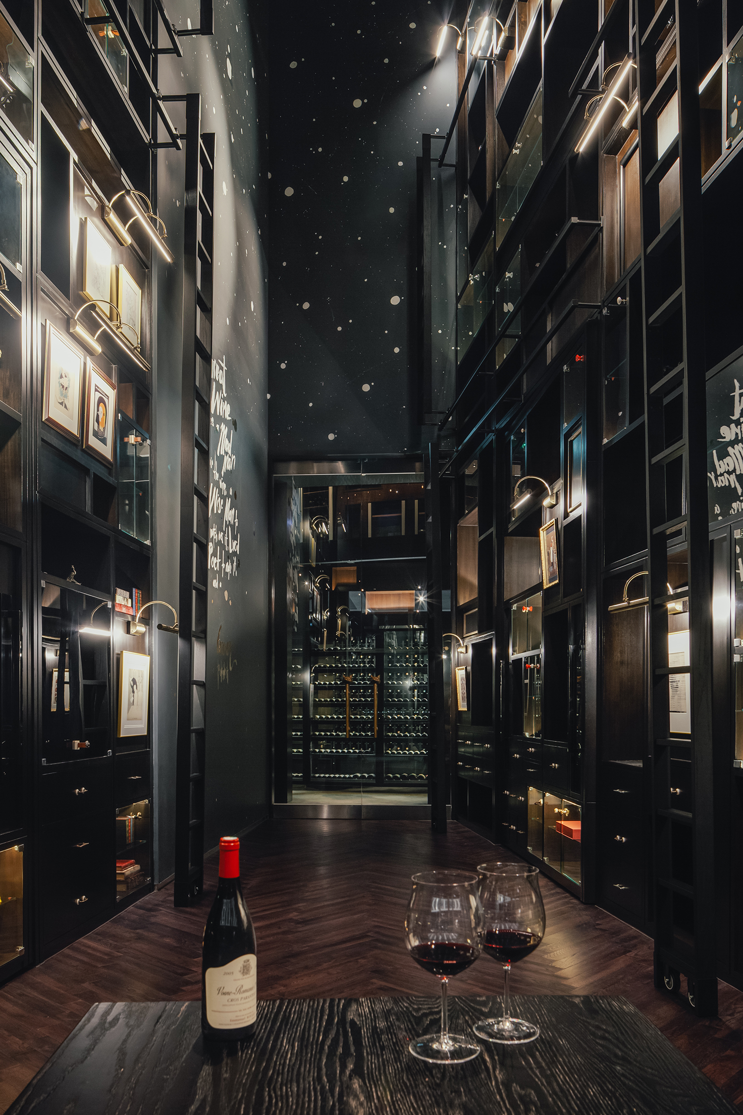 The wine tasting wall is 16 meters high and features three levels of catwalks and LED/fiber optic starlight elements that play into the lunar design motif like stars in the sky.